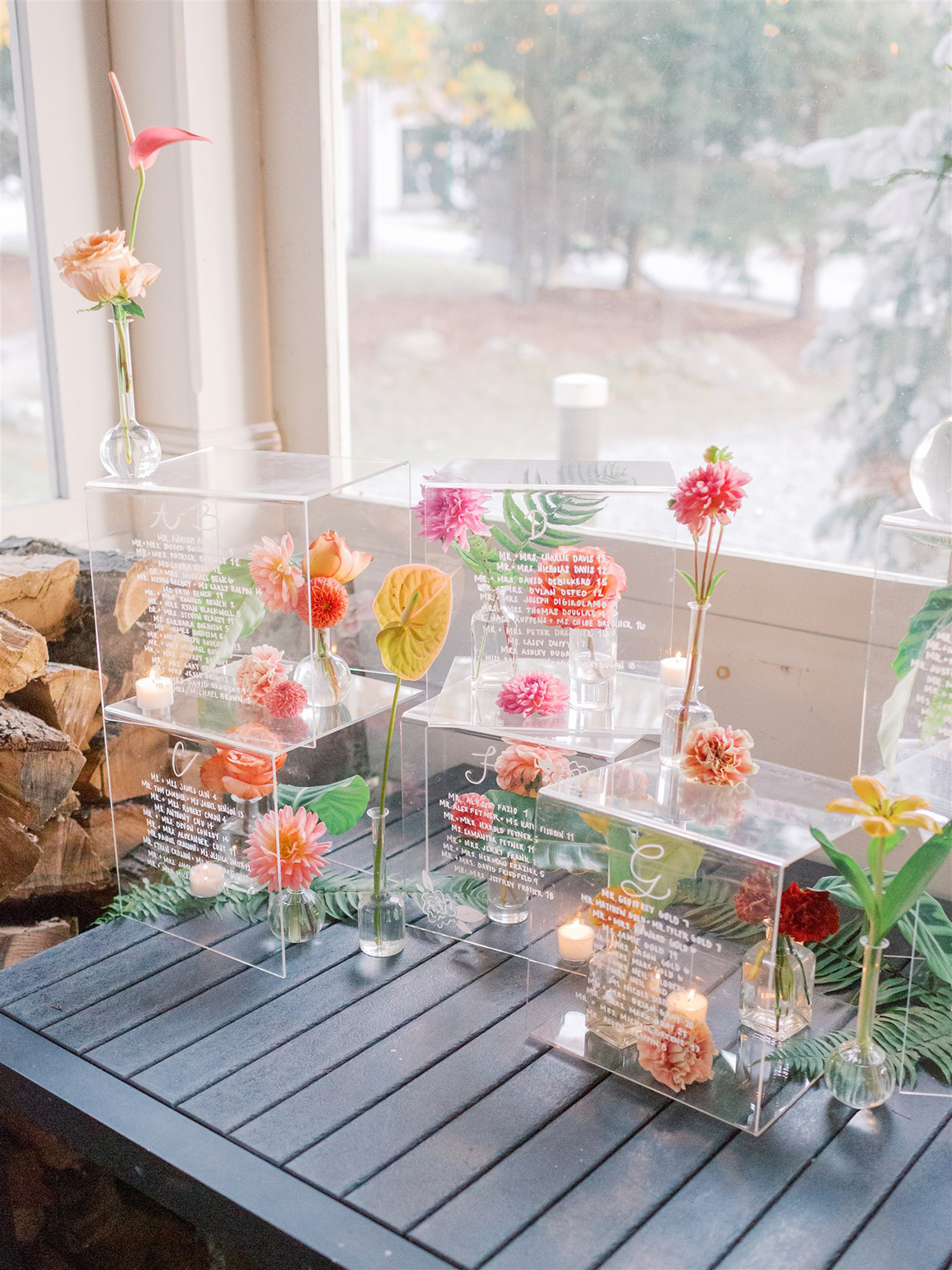 clear cubes with candles and flowers for seating chart