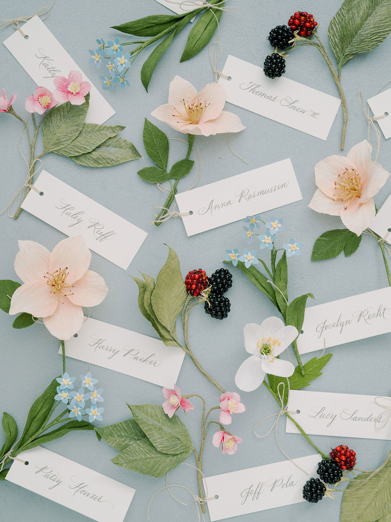 wedding place cards with wildflowers and berries