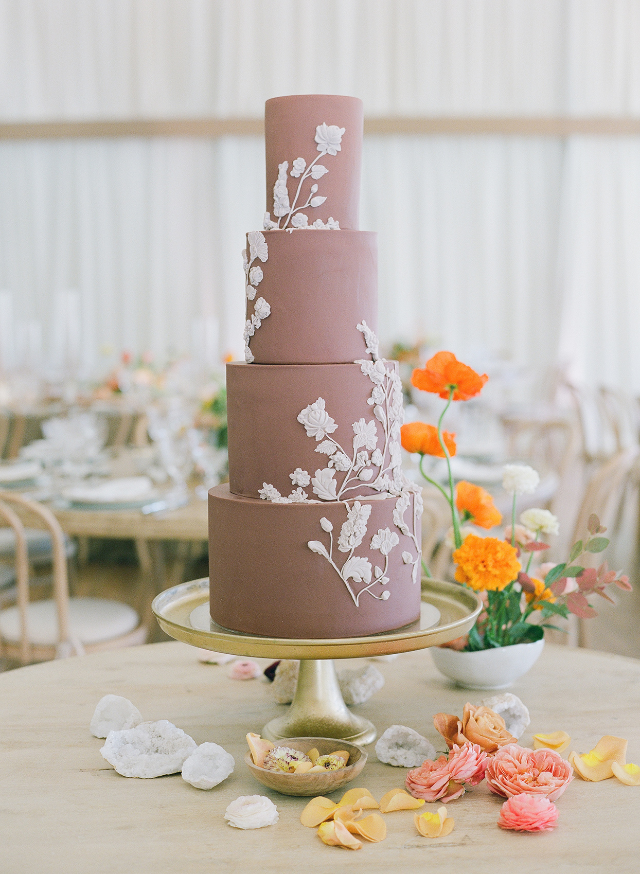 mauve fondant cake with white floral decor
