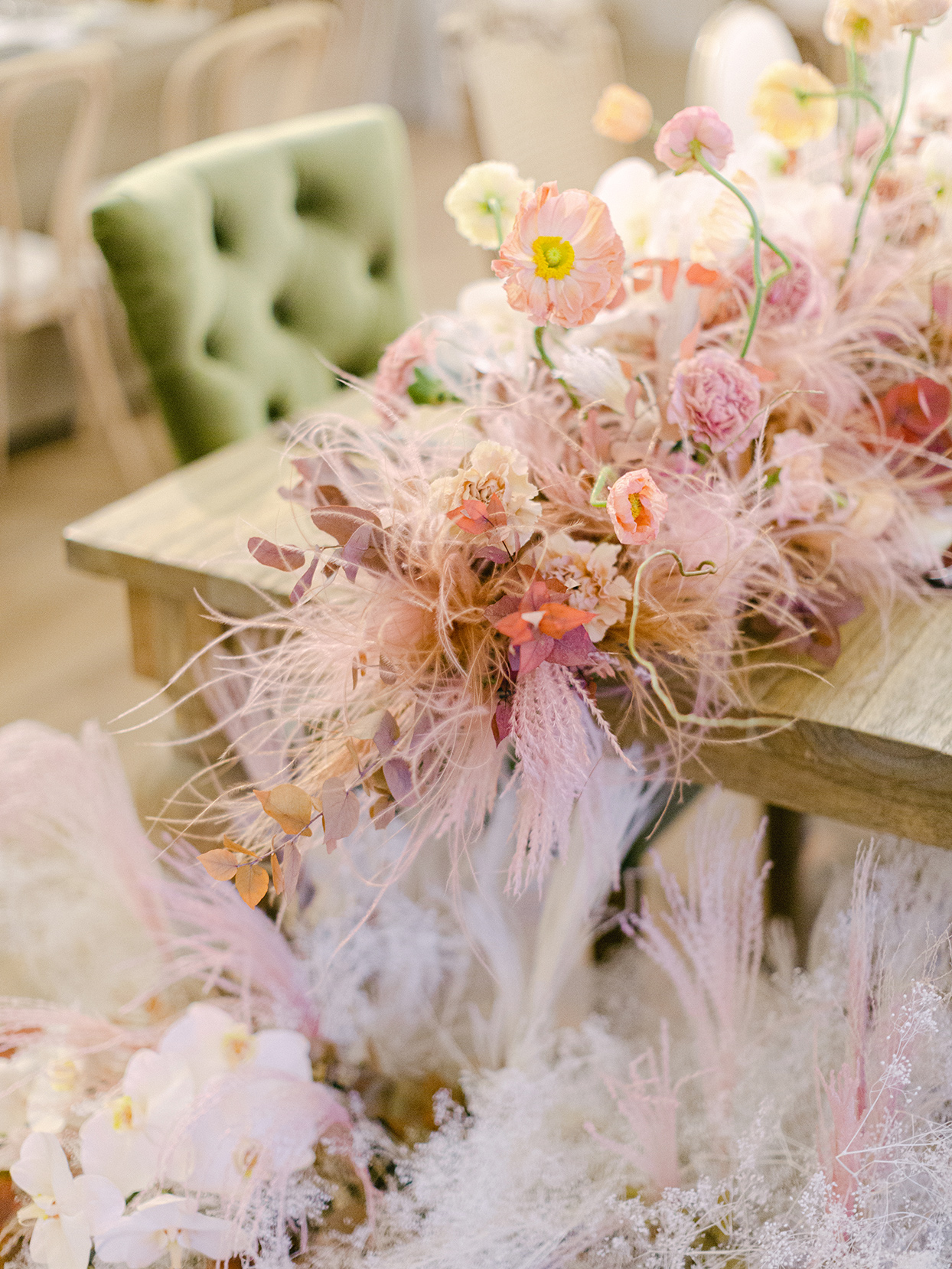 pastel pink floral and feather wedding reception decorations