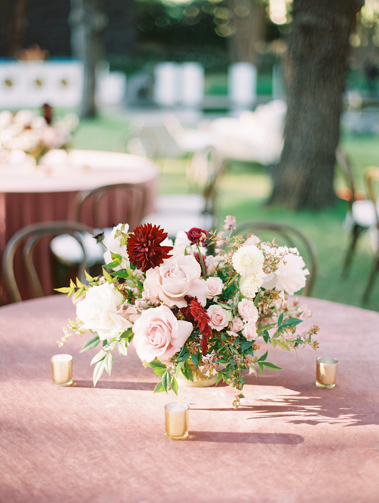 red and pink floral wedding bouquet centerpiece