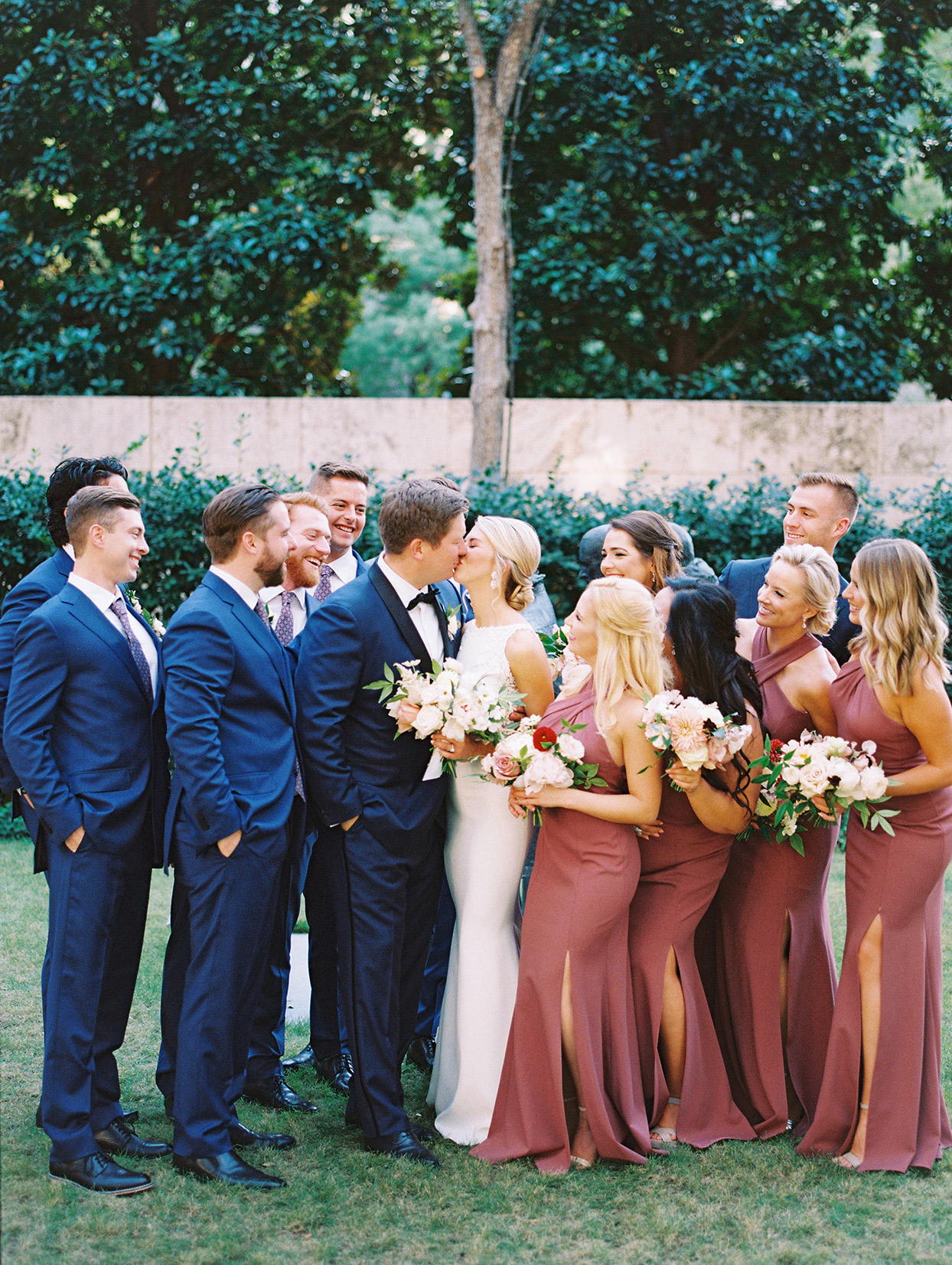 bride and groom with wedding party in blue and red
