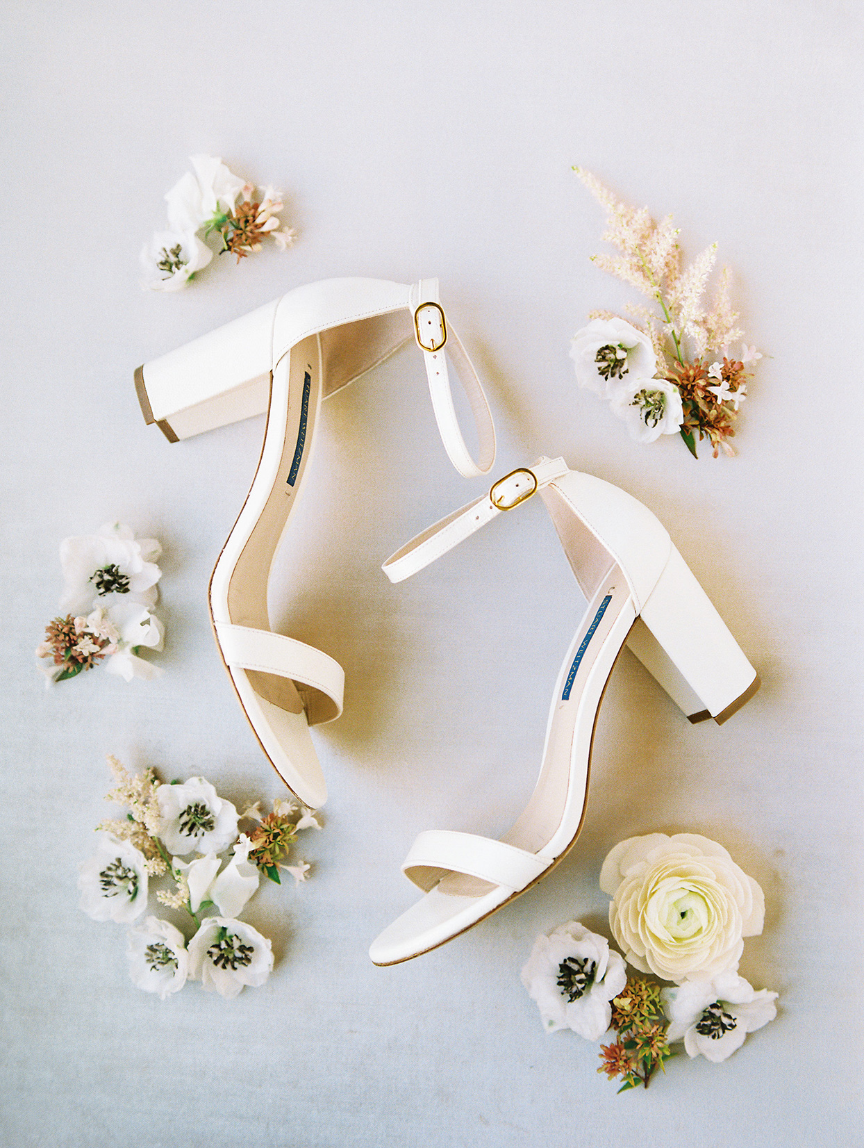 bride's simple cream colored wedding shoes