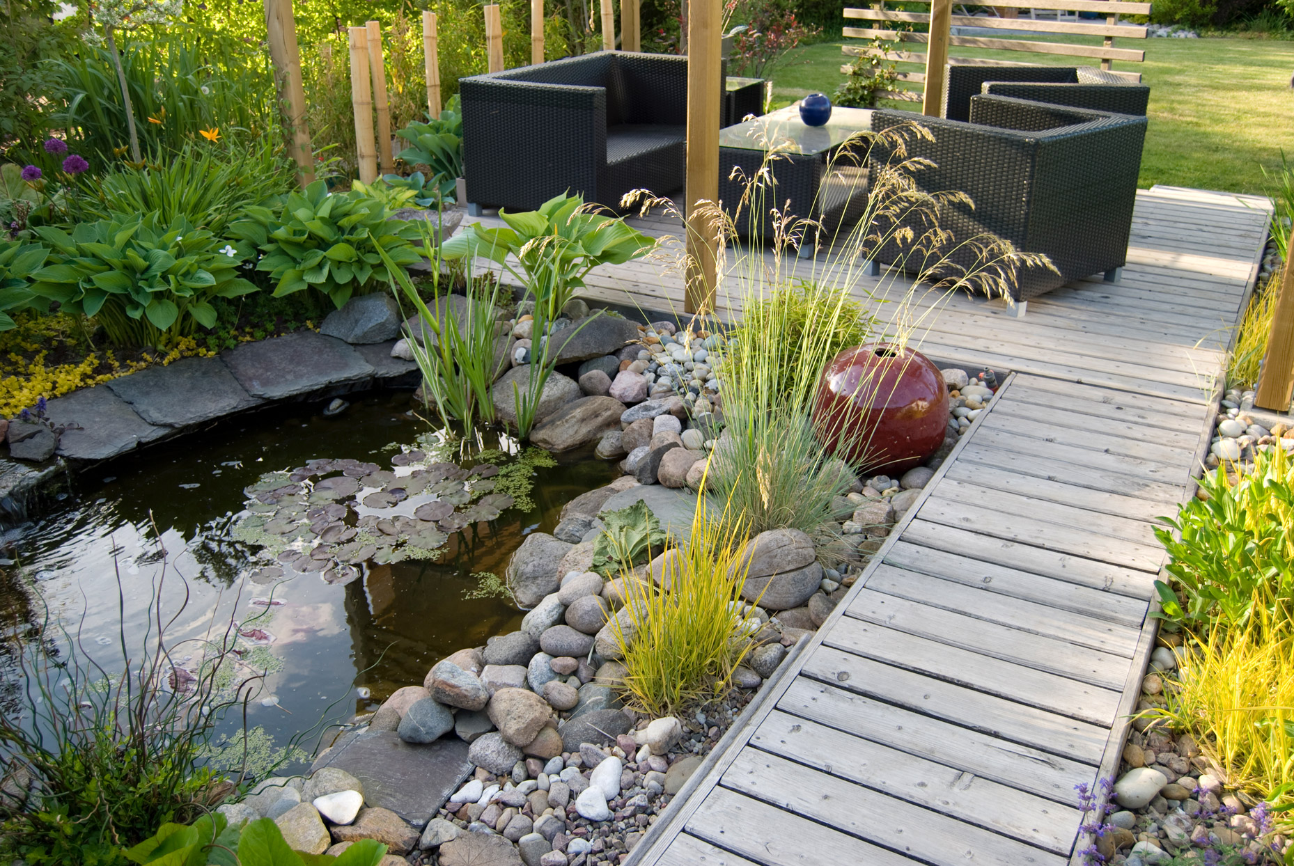 small pond backyard patio area