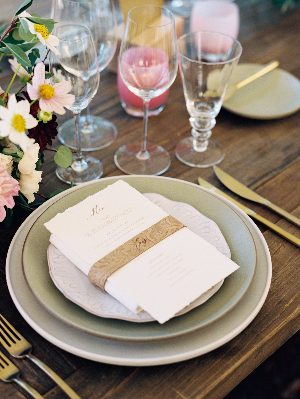 elegant wedding place setting in gold, teal, and pink