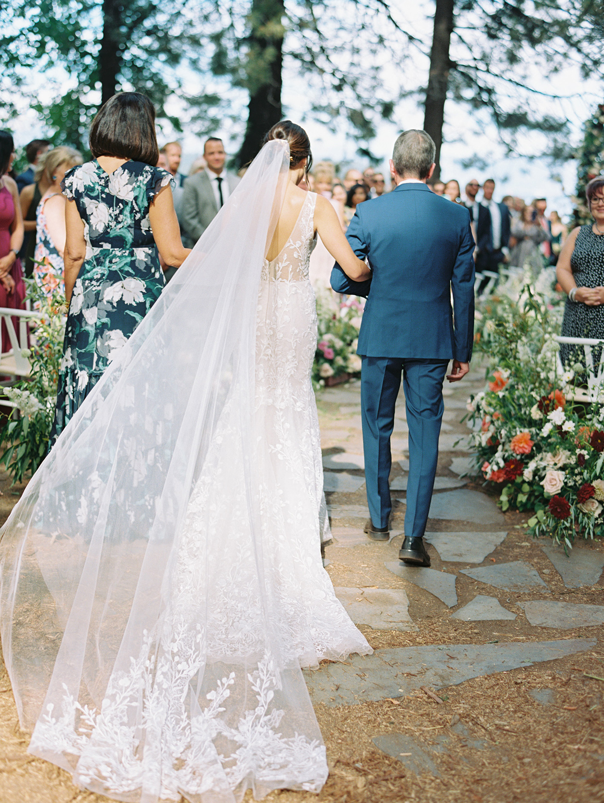 bride and father processing up stone path aisle at wedding ceremony