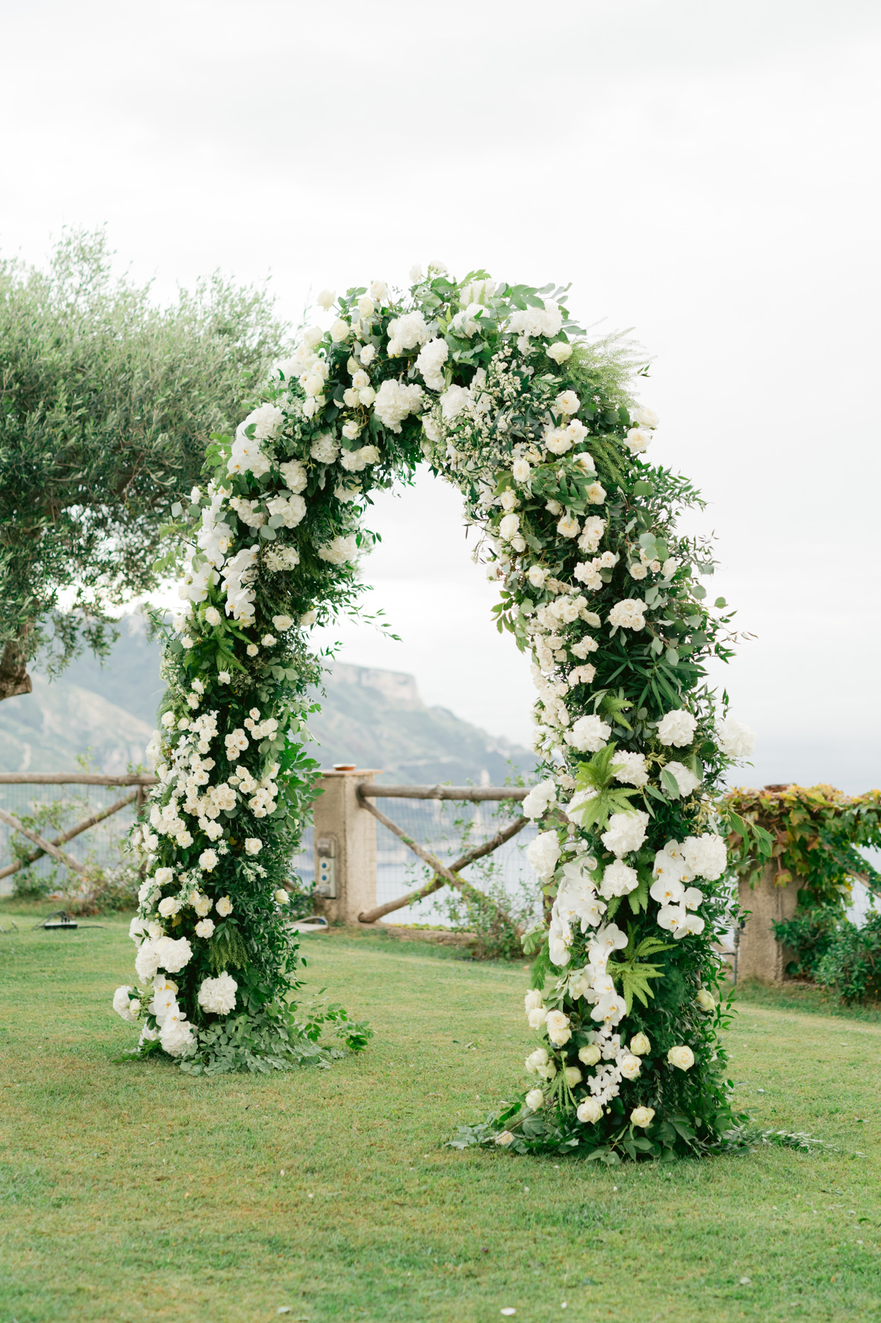 white floral wedding arch outside