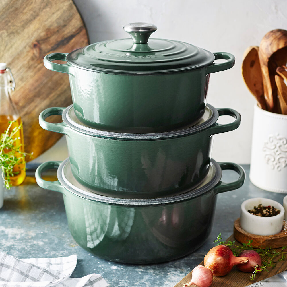 stack of dutch ovens by Le Creuset