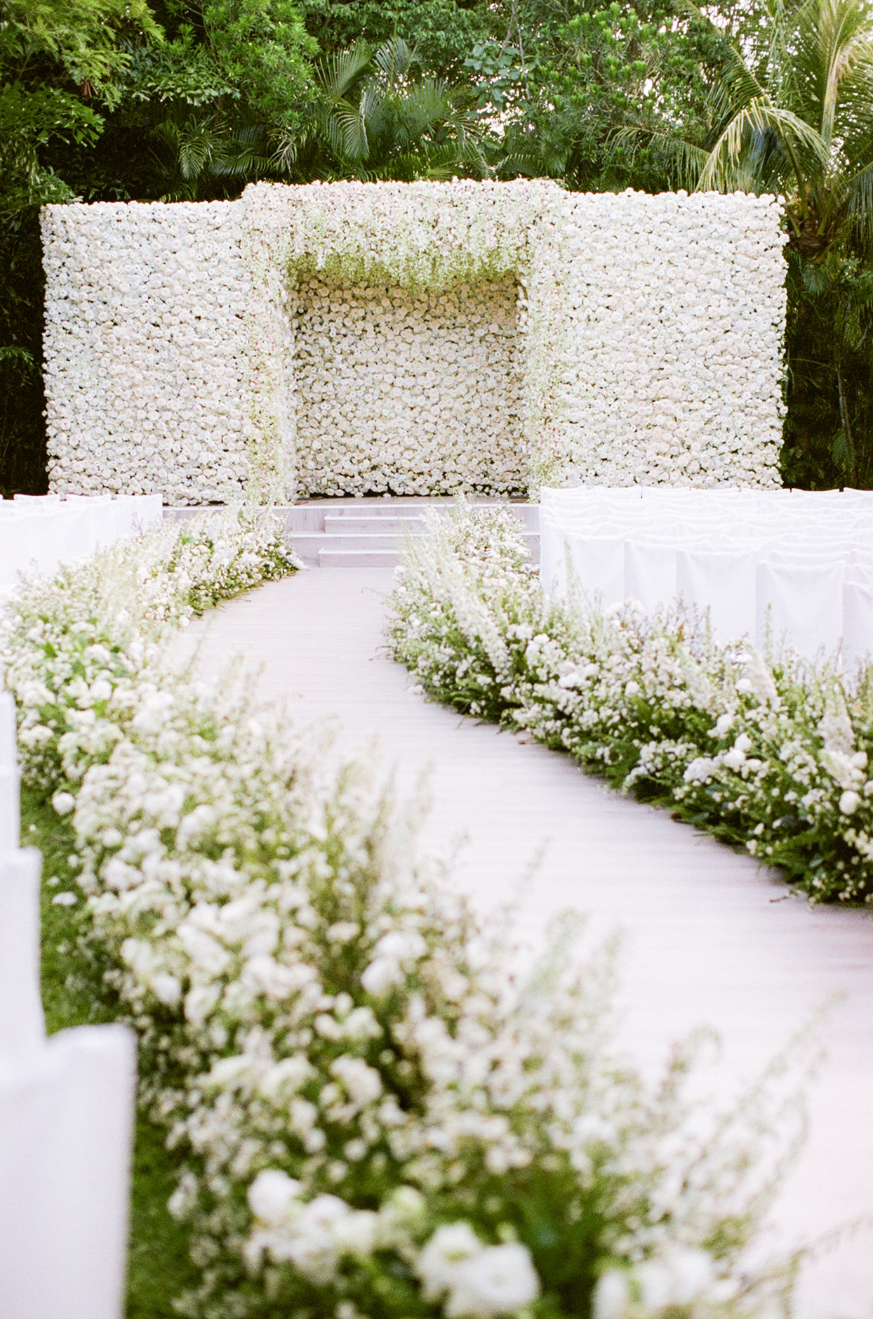 white floral covered wedding backdrop