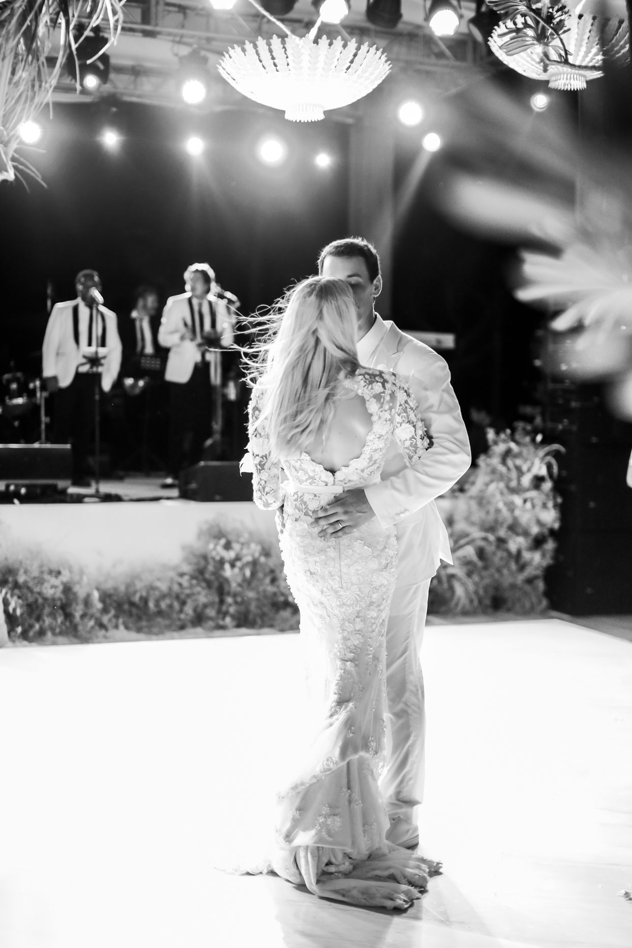 bride and groom share first dance at beach reception