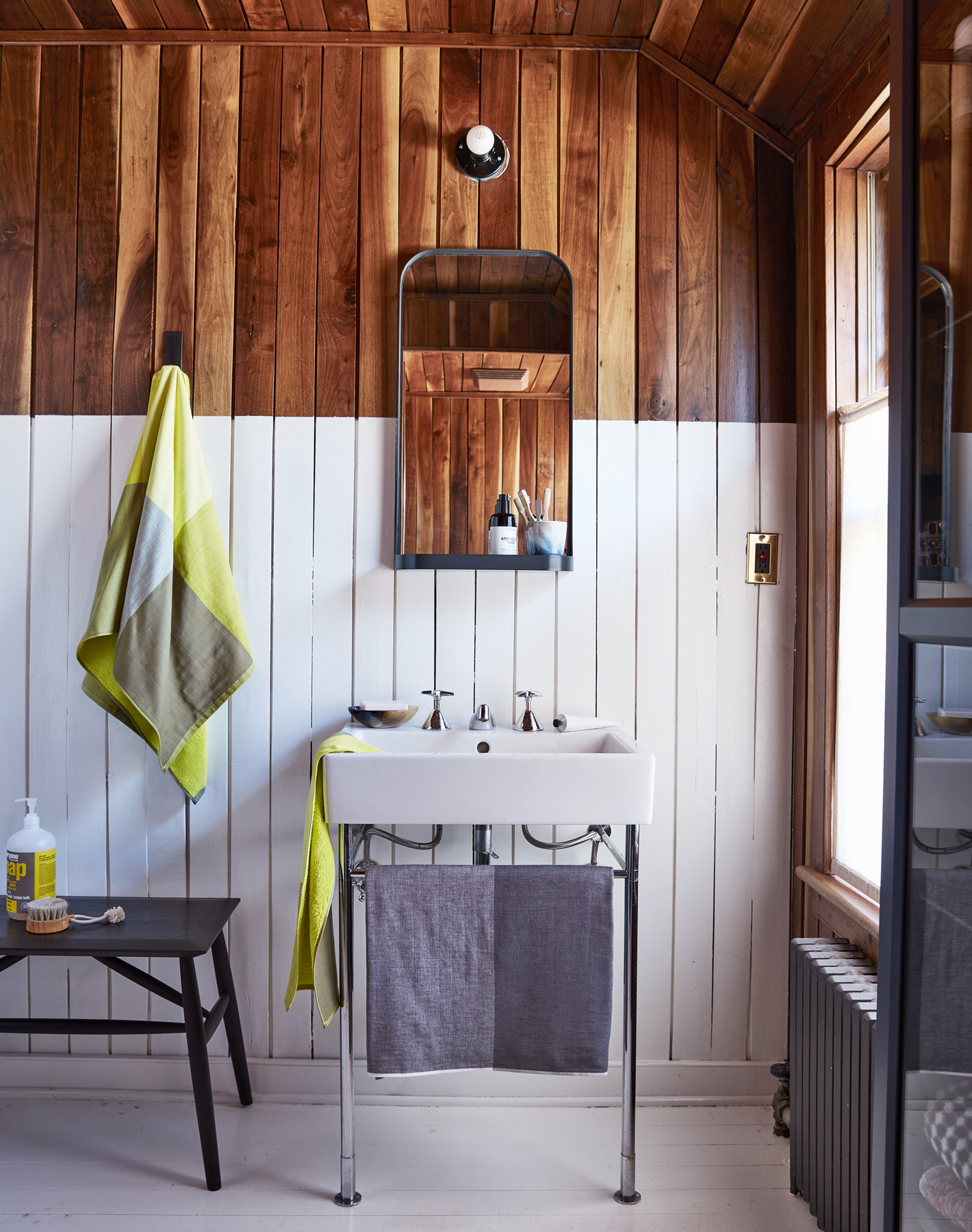 bathroom with wooden paneling bottom-half painted white