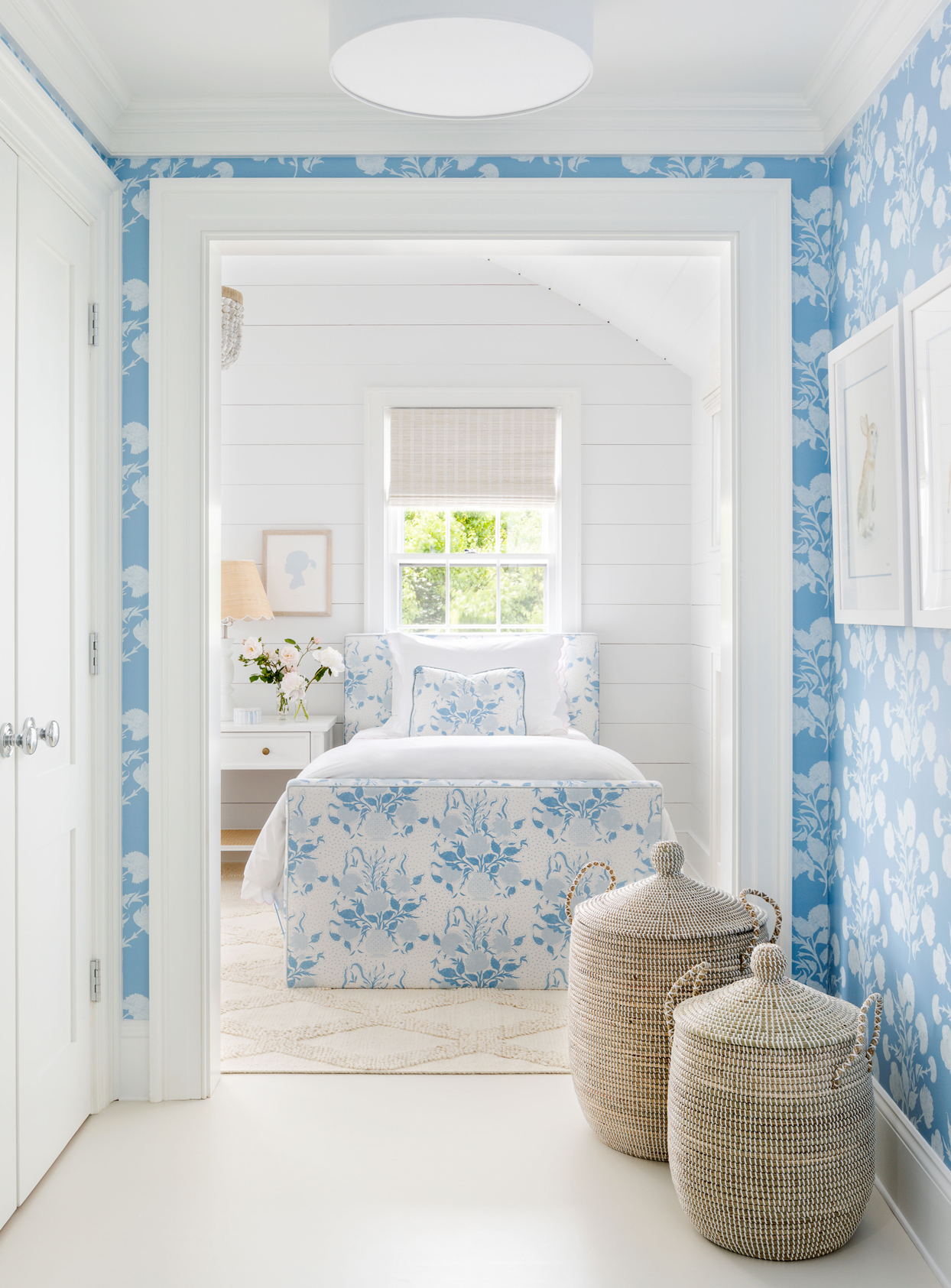 hallway with blue floral wallpaper