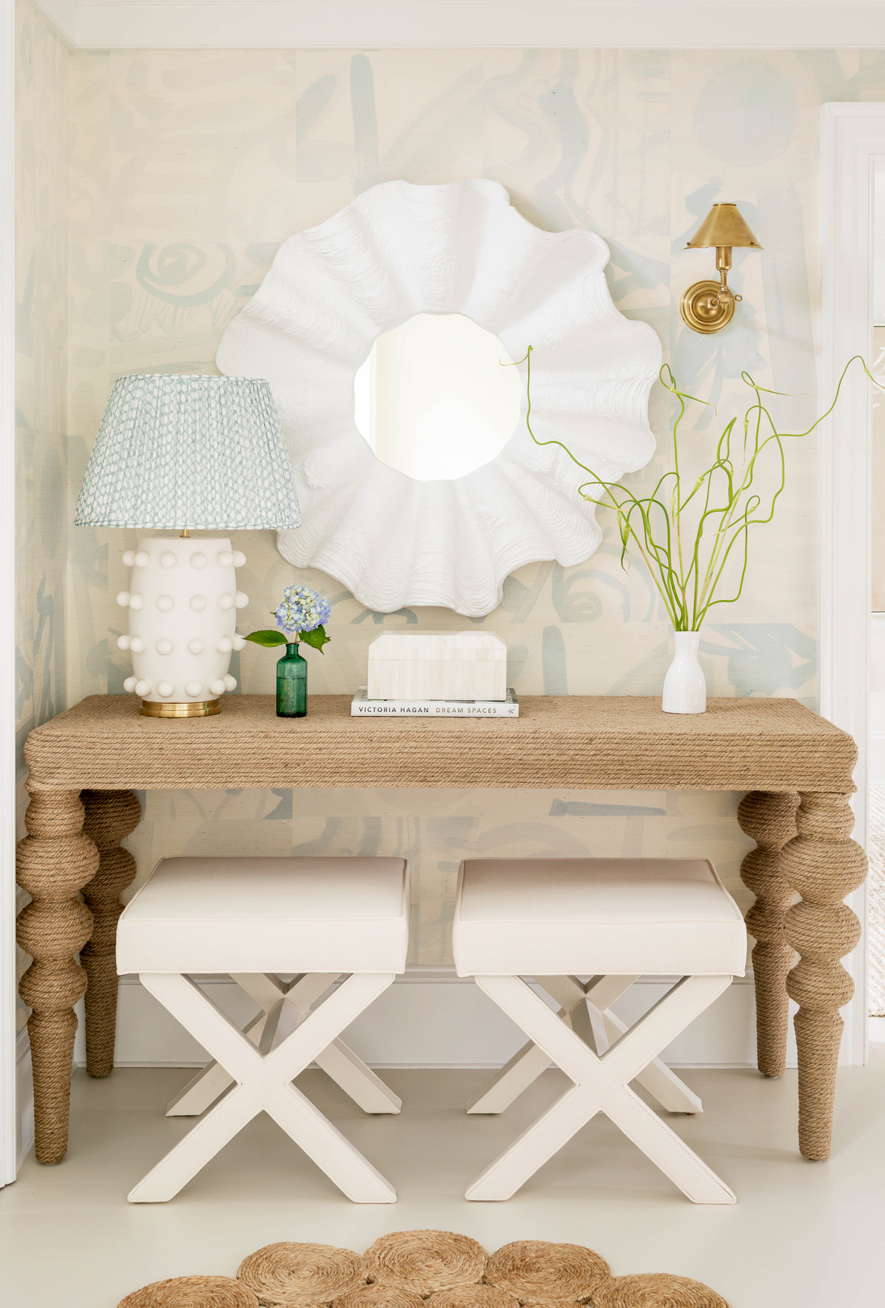 rope-wrapped console and wavy mirror