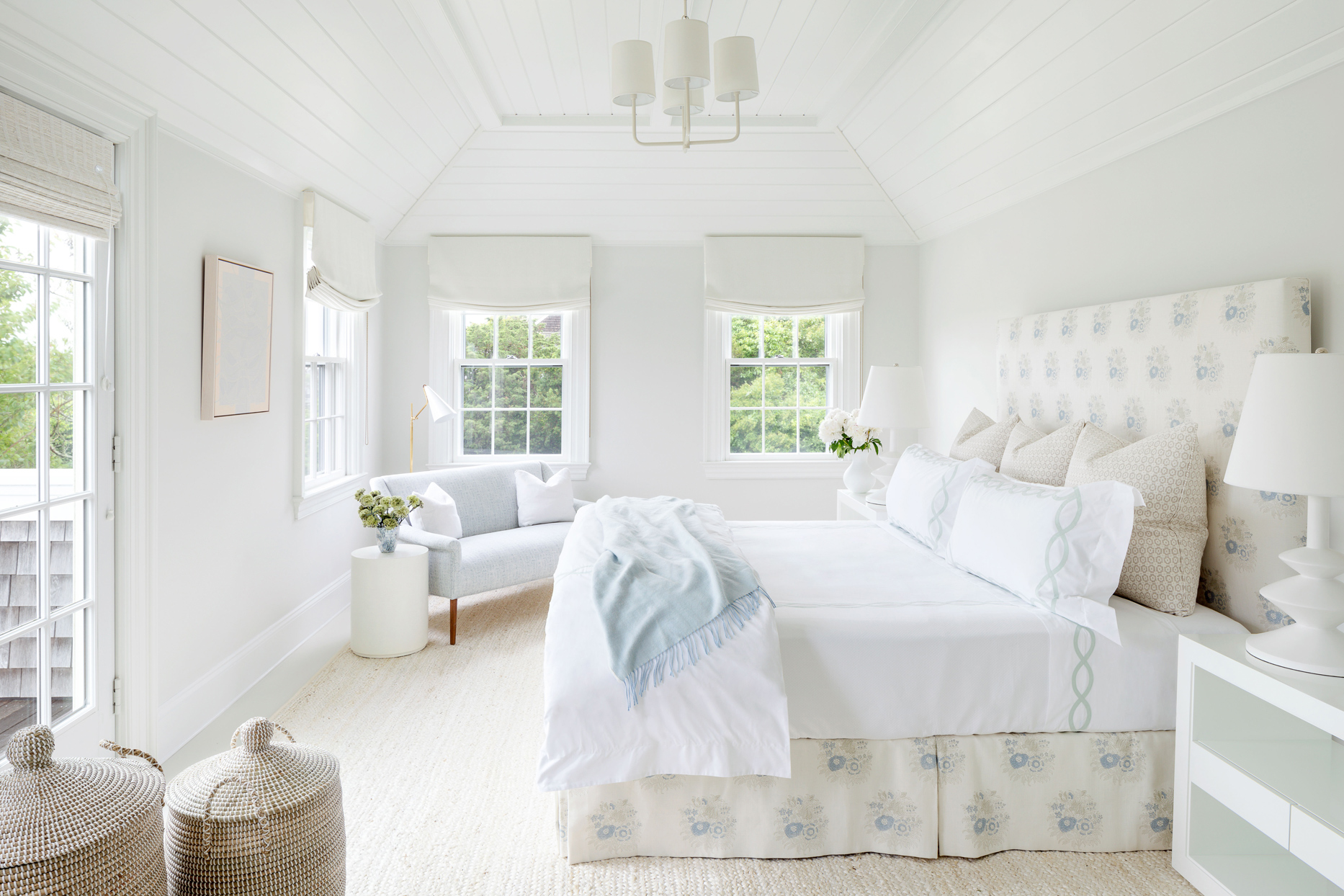 bright white master bedroom with pale blue accents
