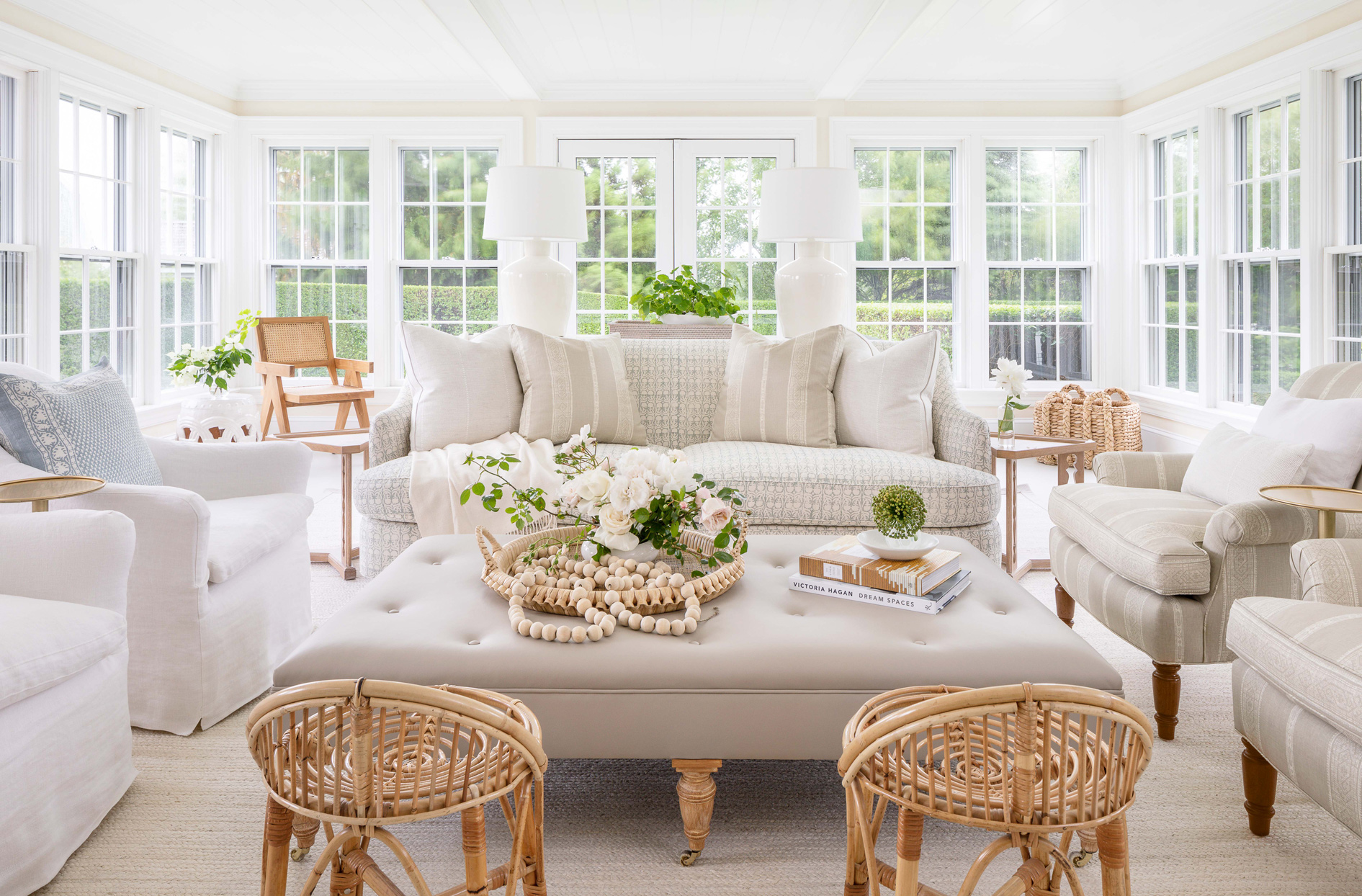 neutral-colored living room with greenery accents