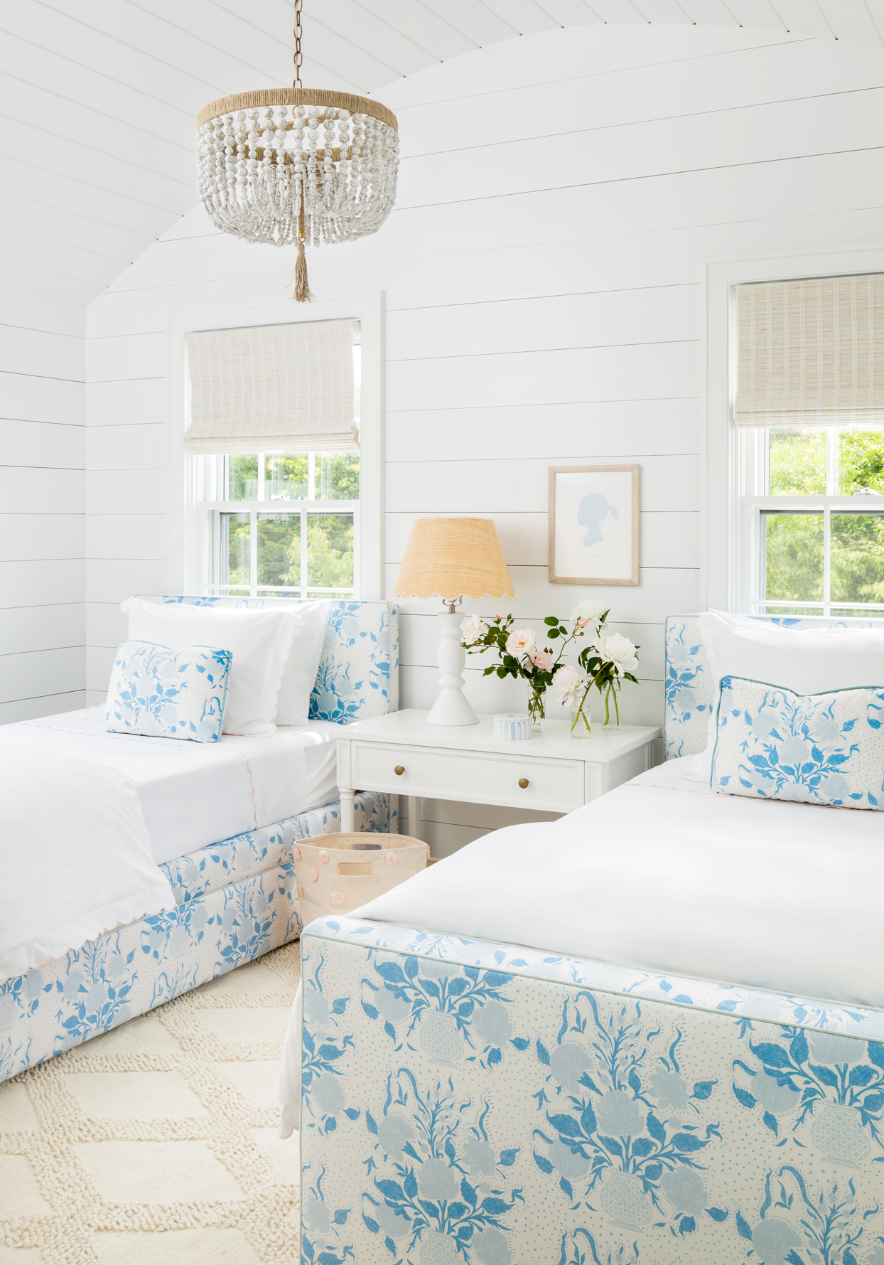 twin beds with blue floral upholstered headboards