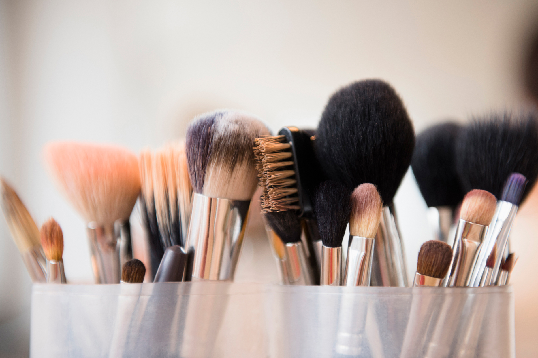assorted make up brushes in container