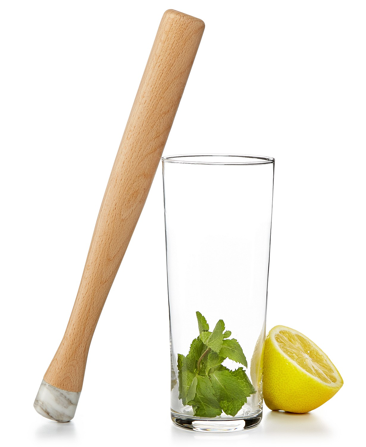 muddler and glass with mint and half a lemon