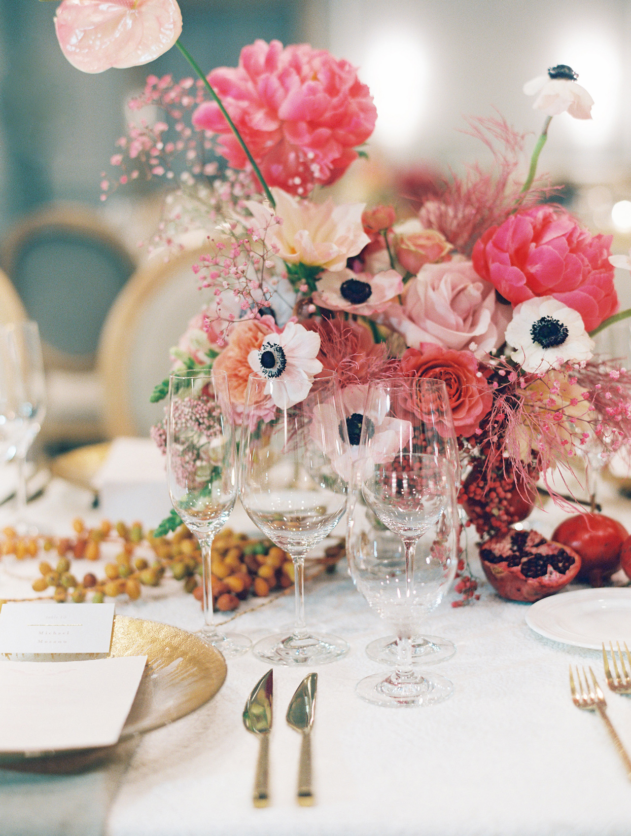 pink floral centerpiece and gold place settings