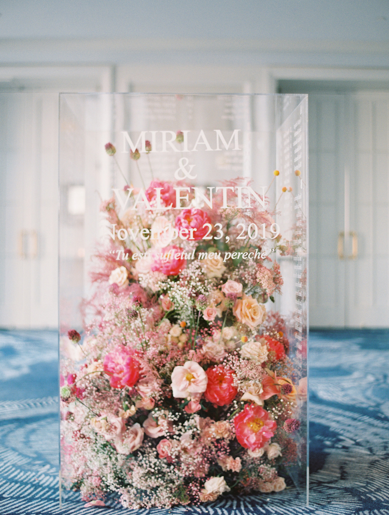 floral filled clear acrylic seating chart box