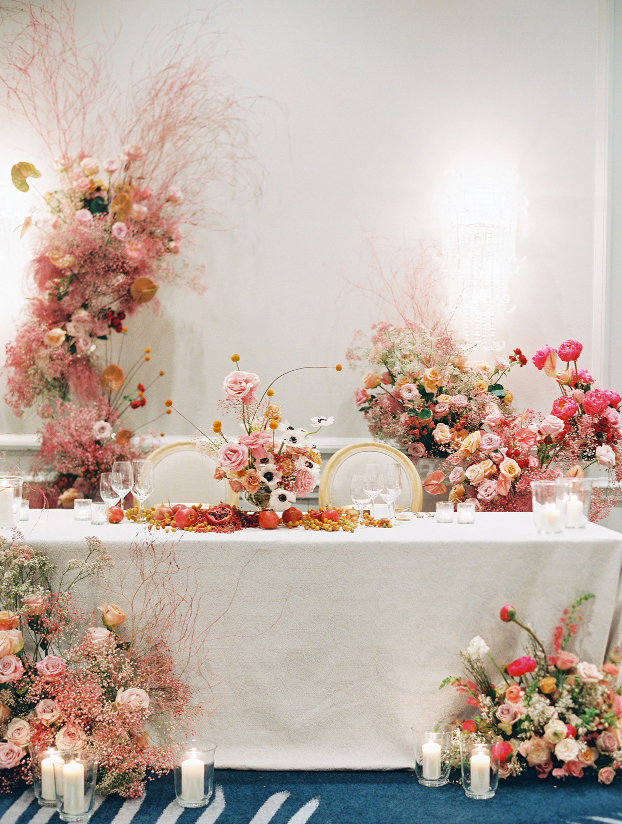sweetheart table surrounded by various floral displays