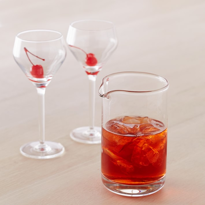 cocktail mixing glass and two glasses