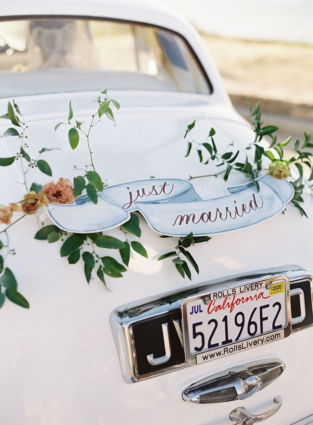 white vintage wedding car with just married sign