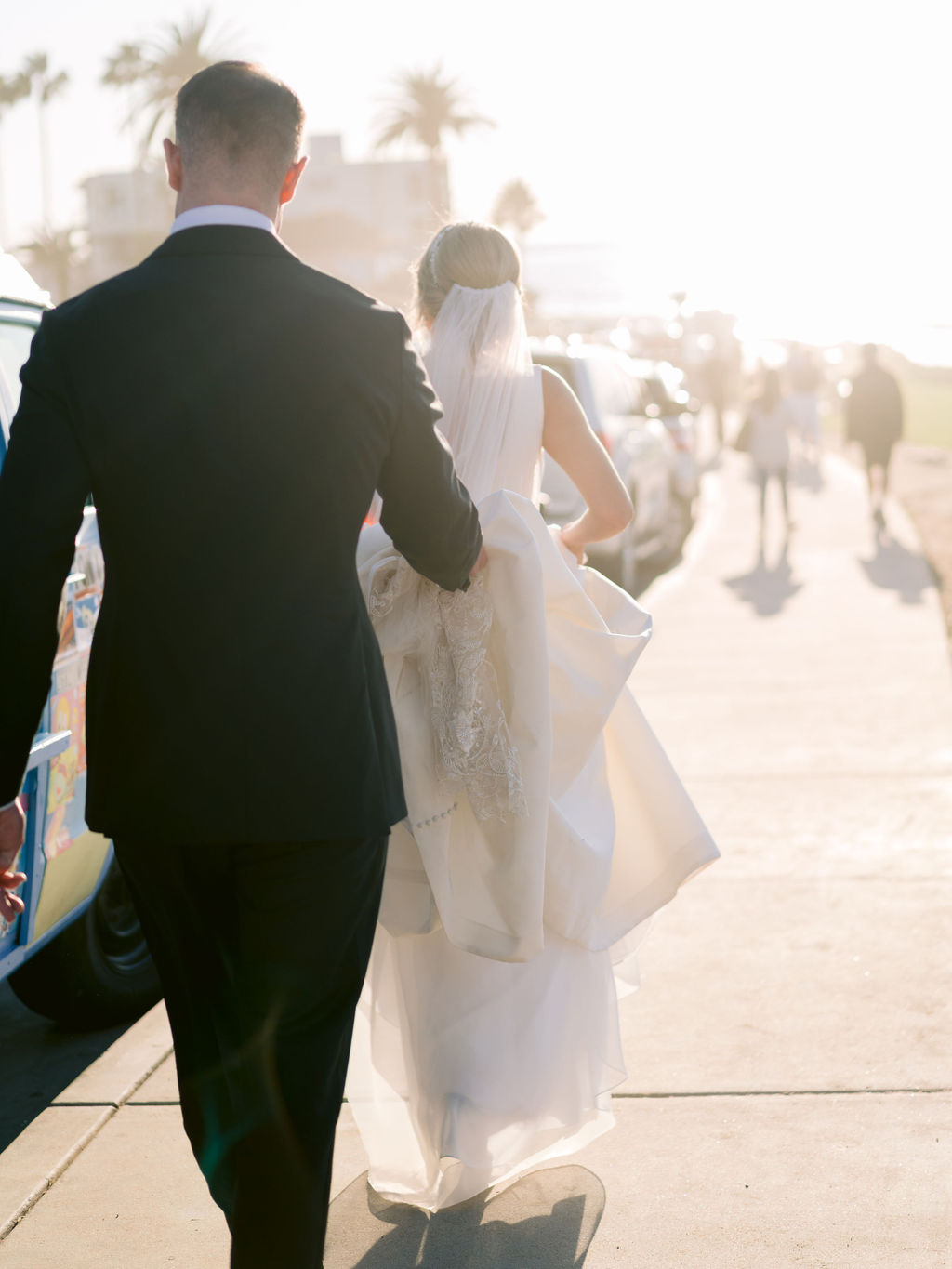 wedding couple walking during the sunset