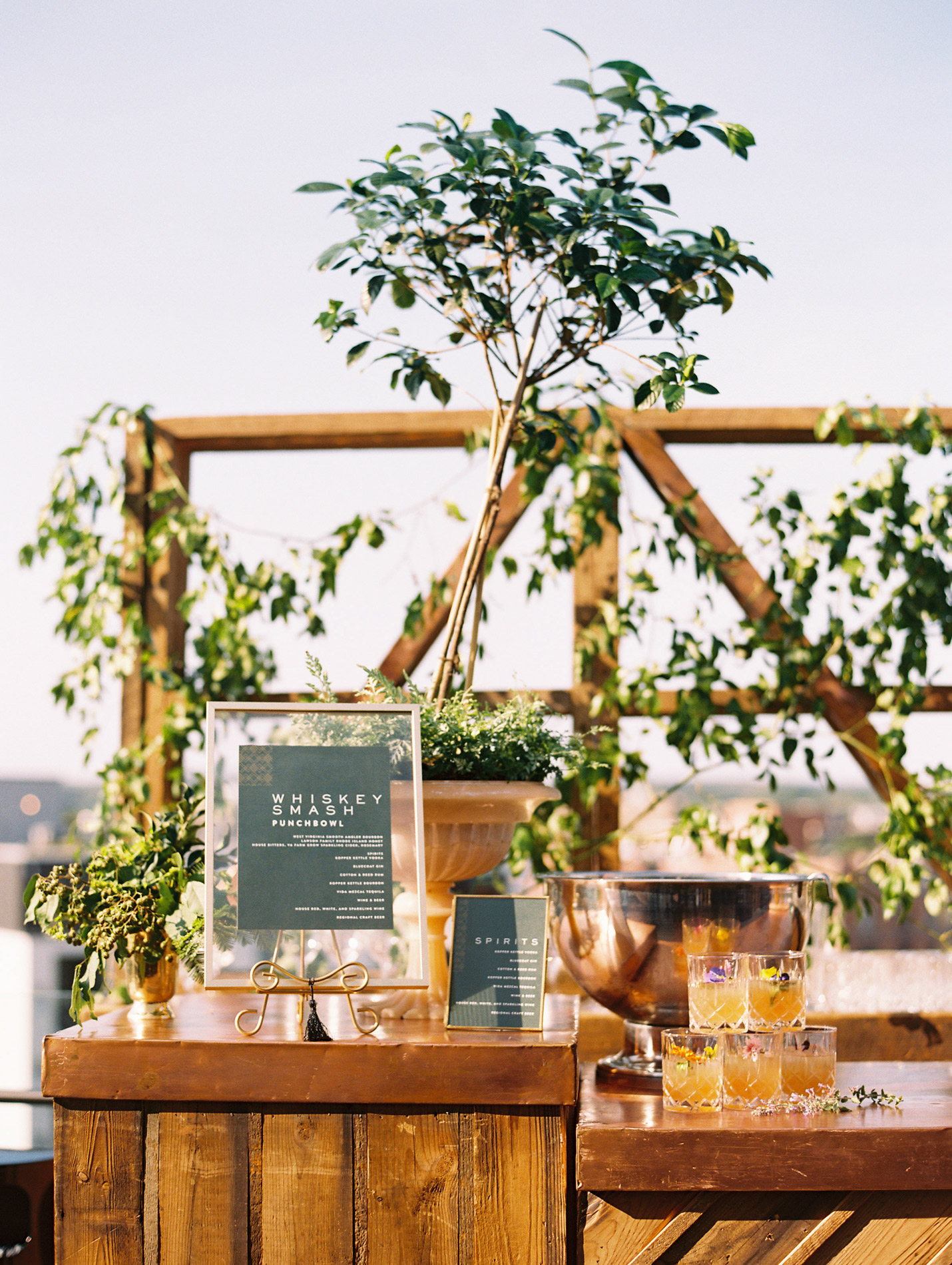 wooden outdoor wedding bar with framed signage