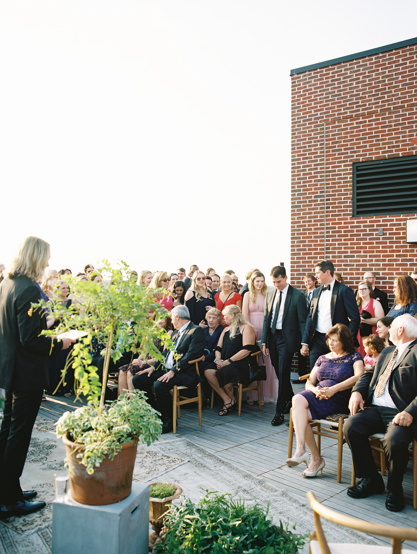 couple during outdoor rooftop wedding processional