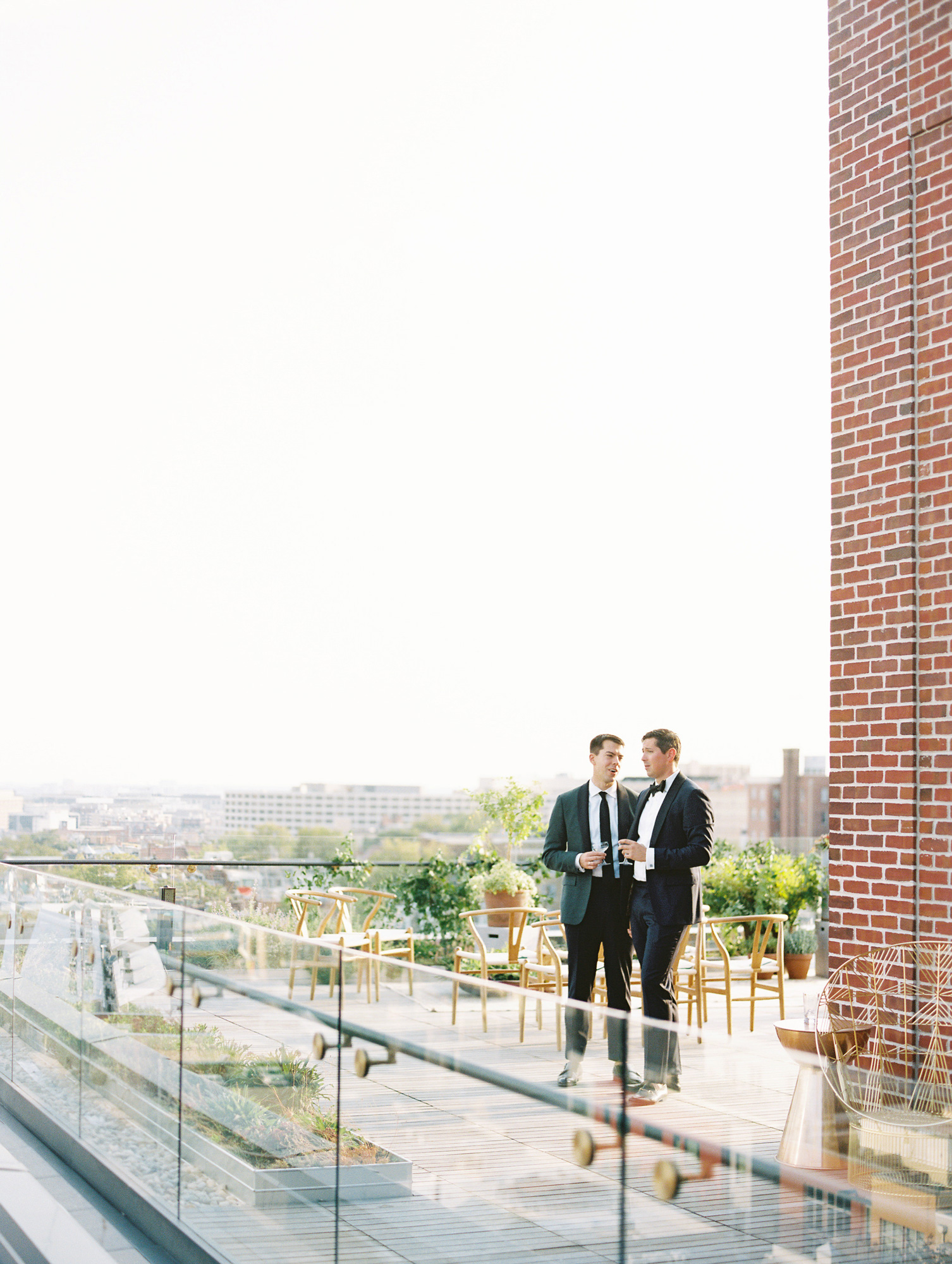 wedding couple sharing a drink alone on the rooftop