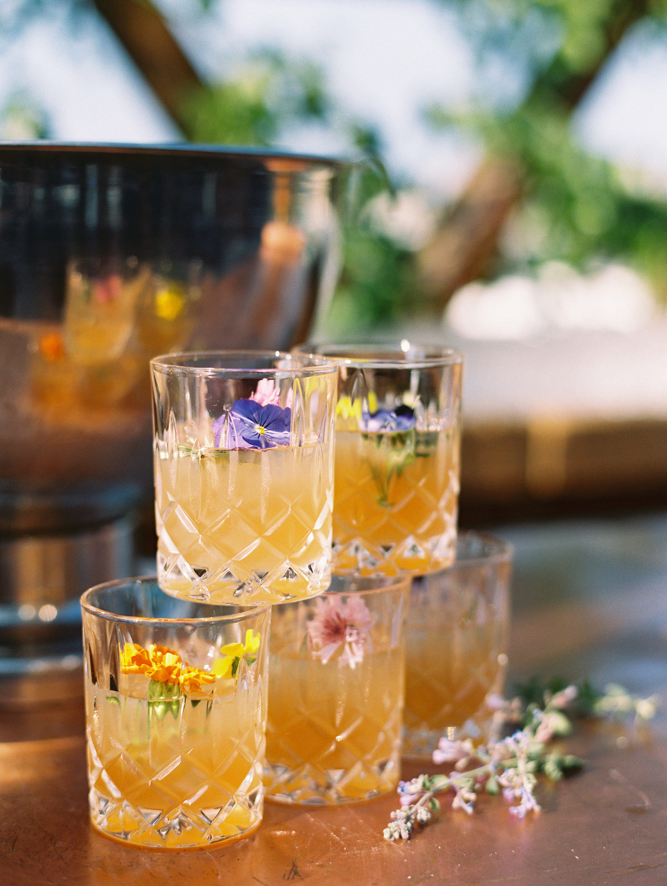 close-up of stacked cocktail glasses with floral accents