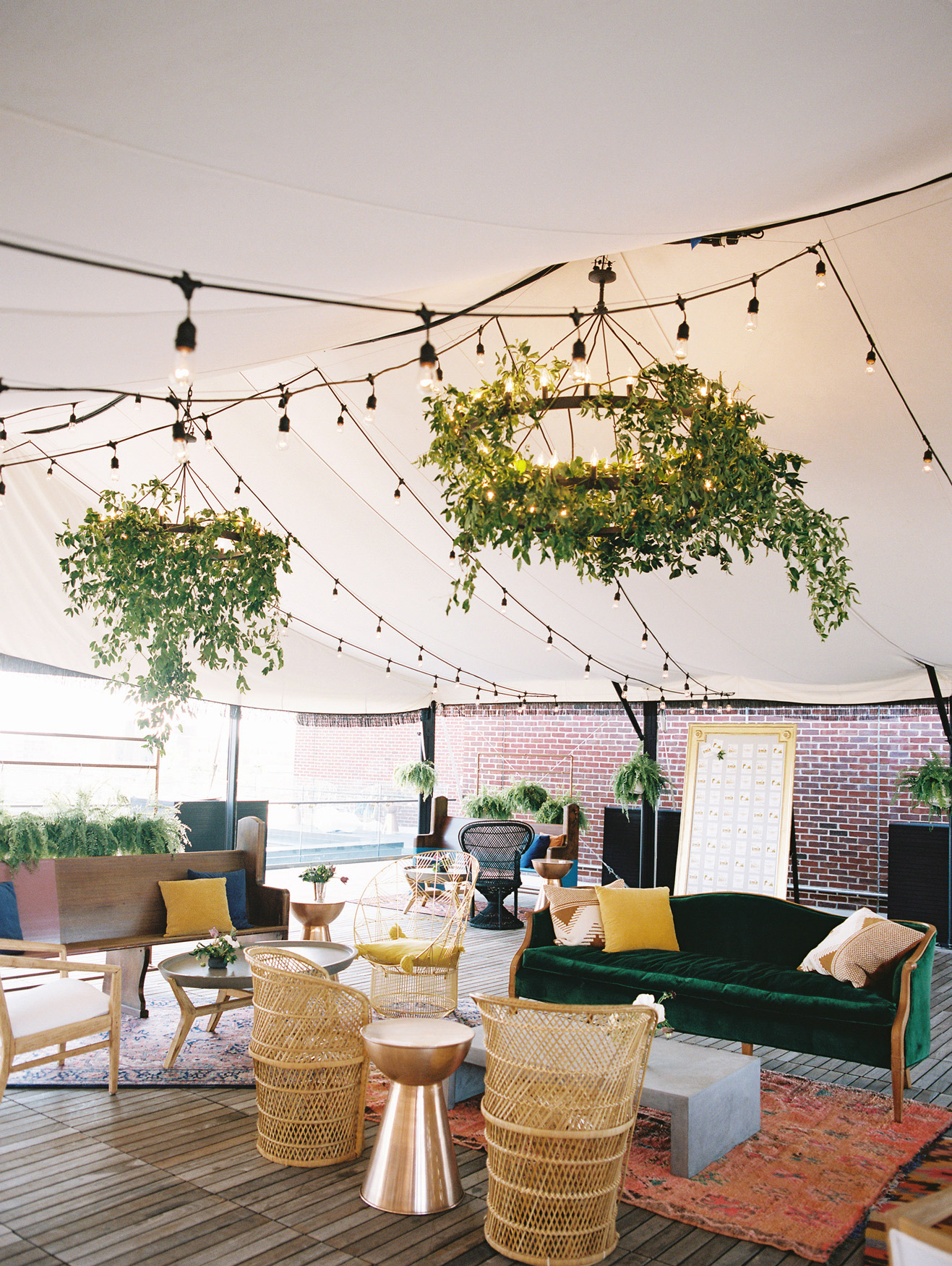 wedding lounge with assorted seating and string lights