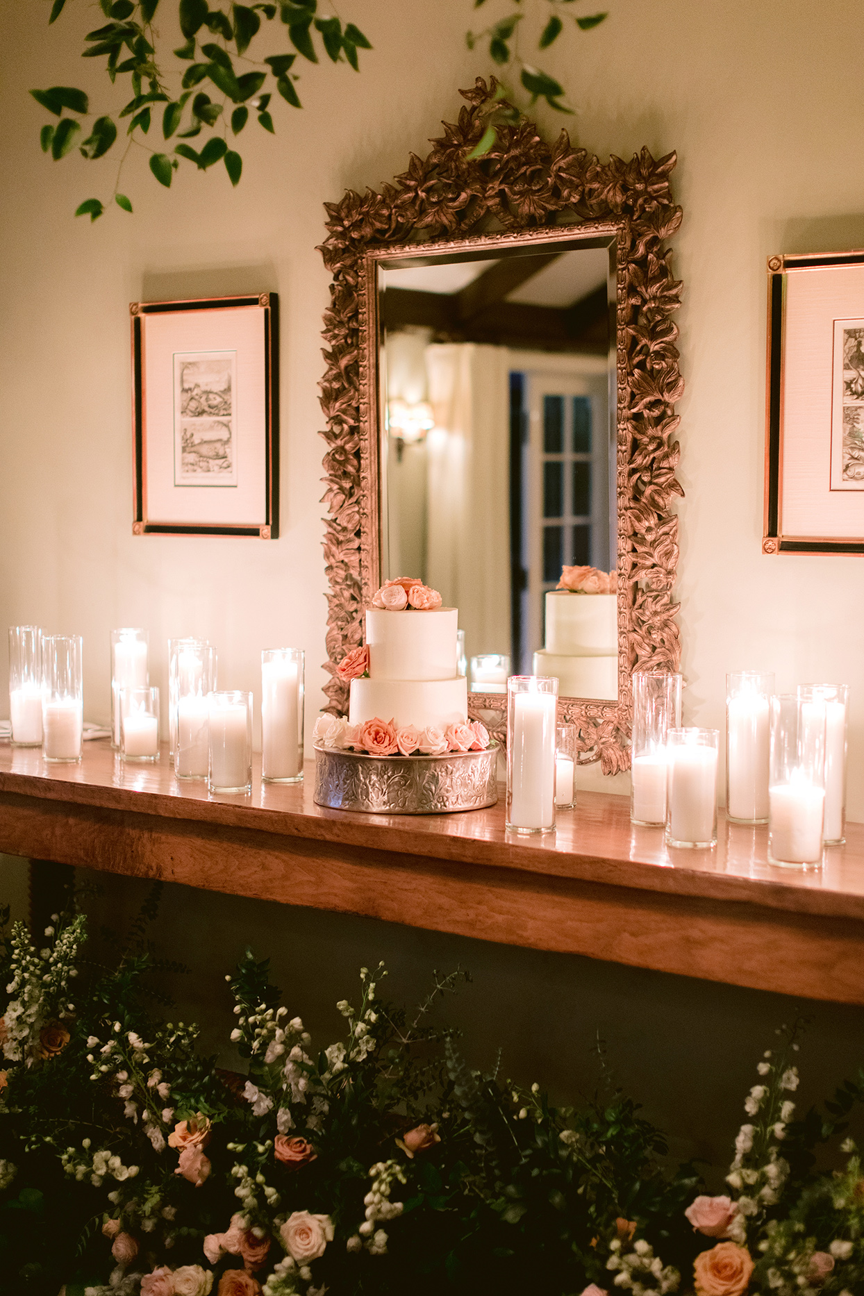 wooden table with candles and wedding cake