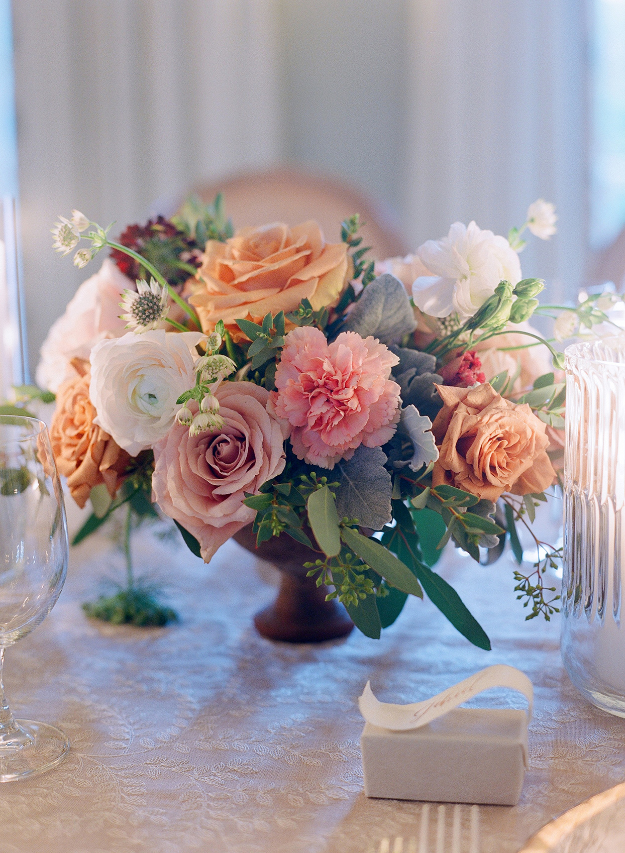 pastel floral wedding centerpiece on table