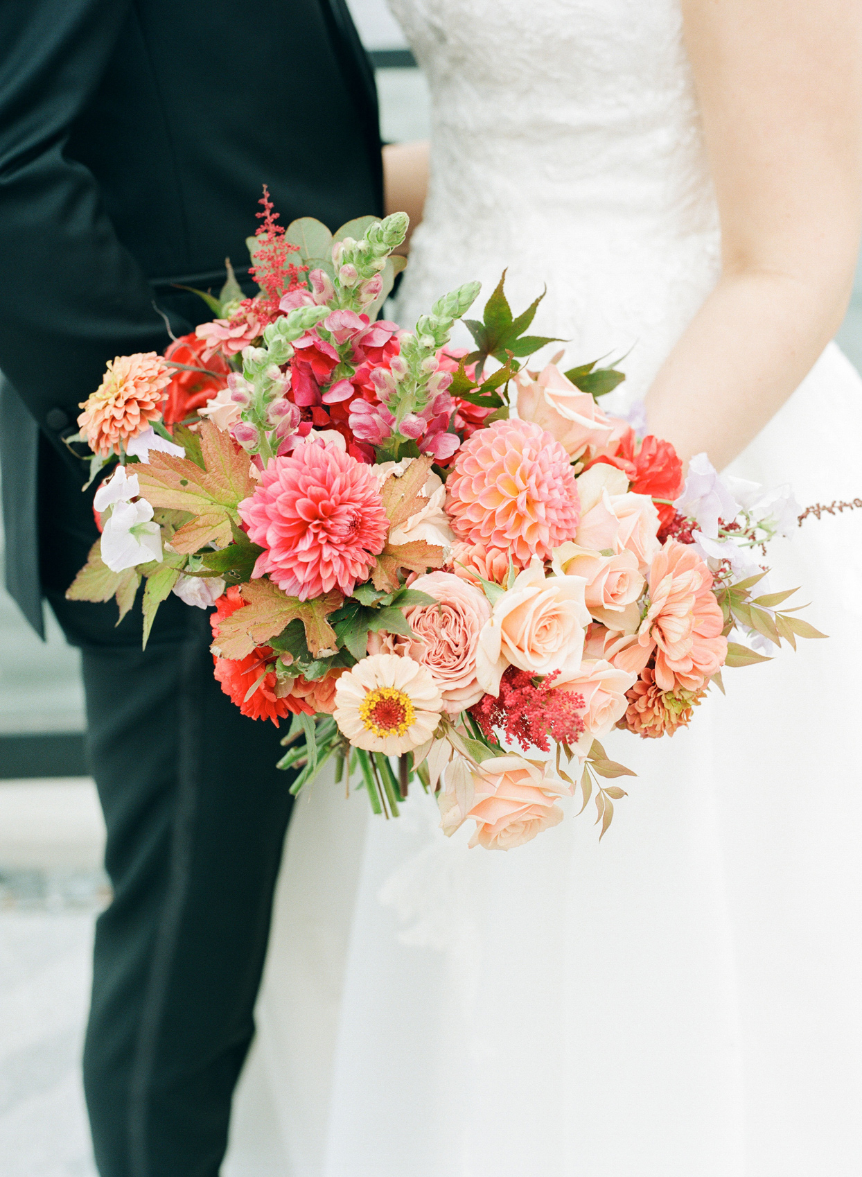pink bridal bouquet with autumn leaves