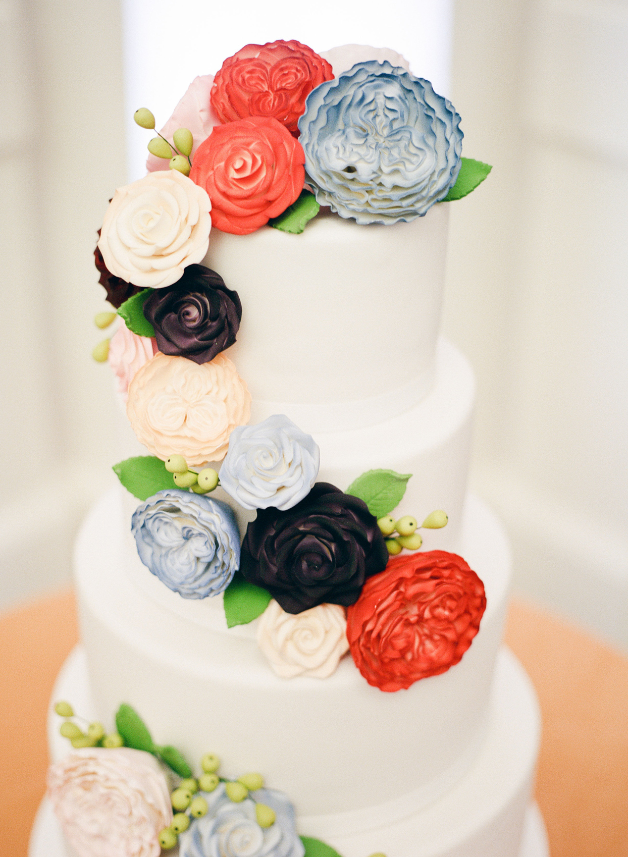 tiered wedding cake decorated with sugar flowers