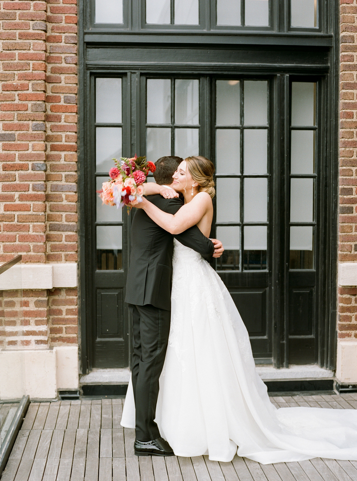bride and groom hugging and sharing first look