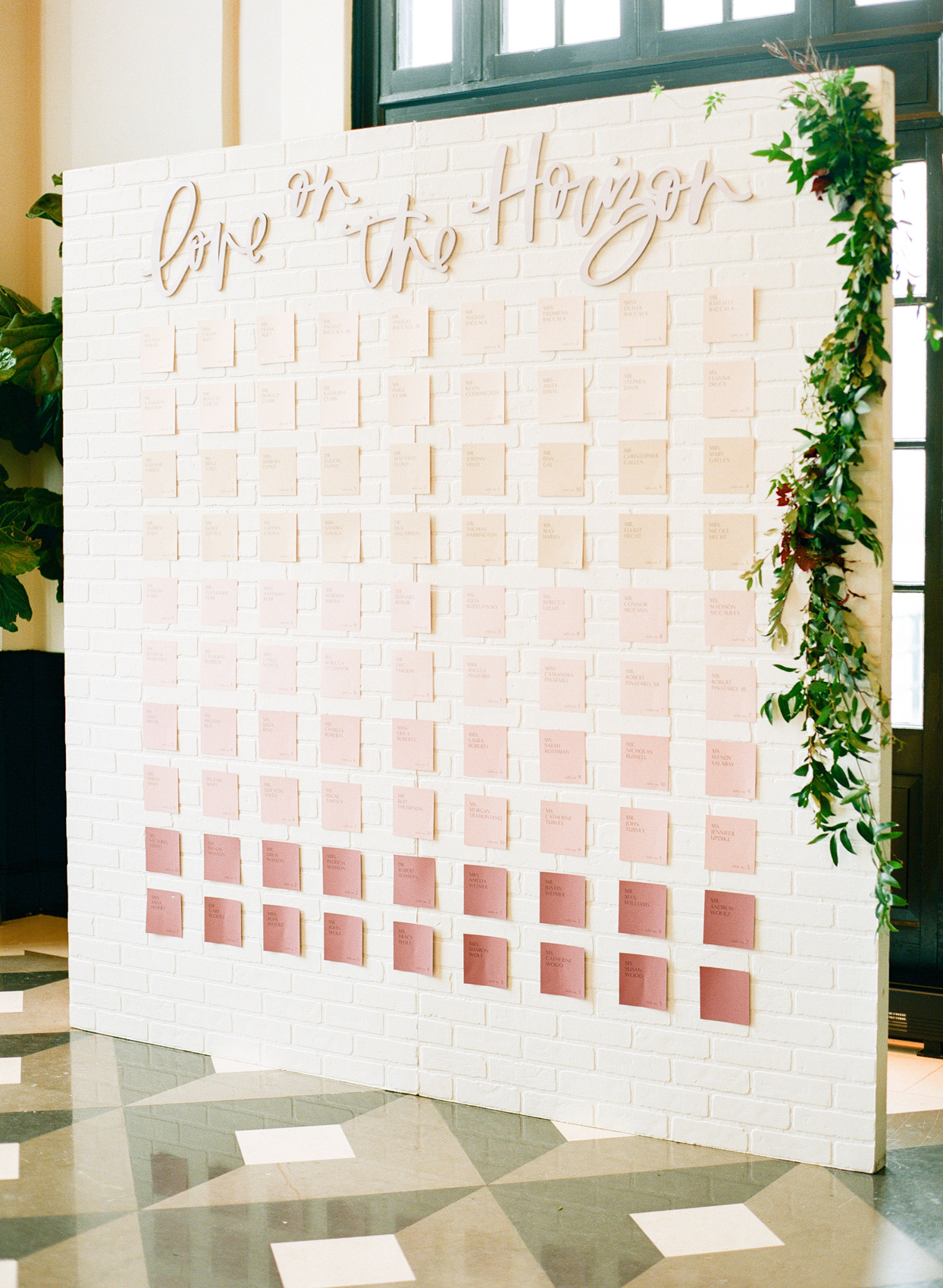 pink ombre escort card wall display