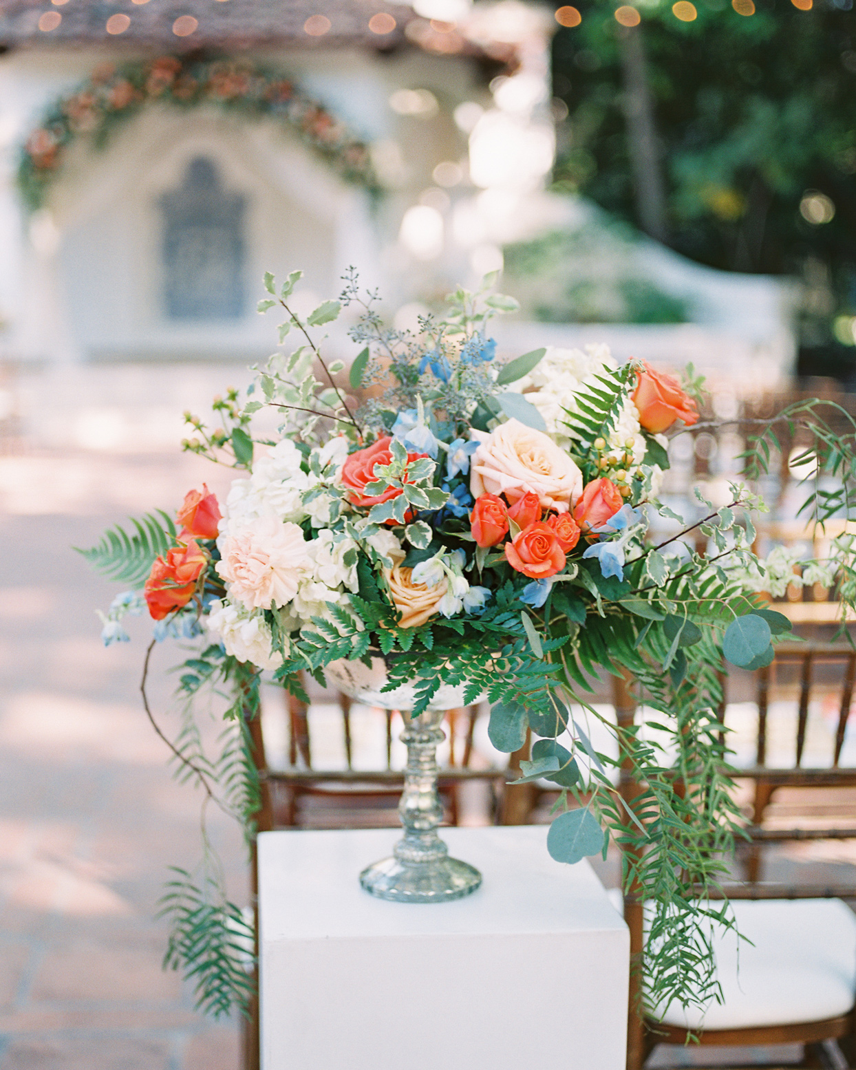 tall floral wedding decor in vase