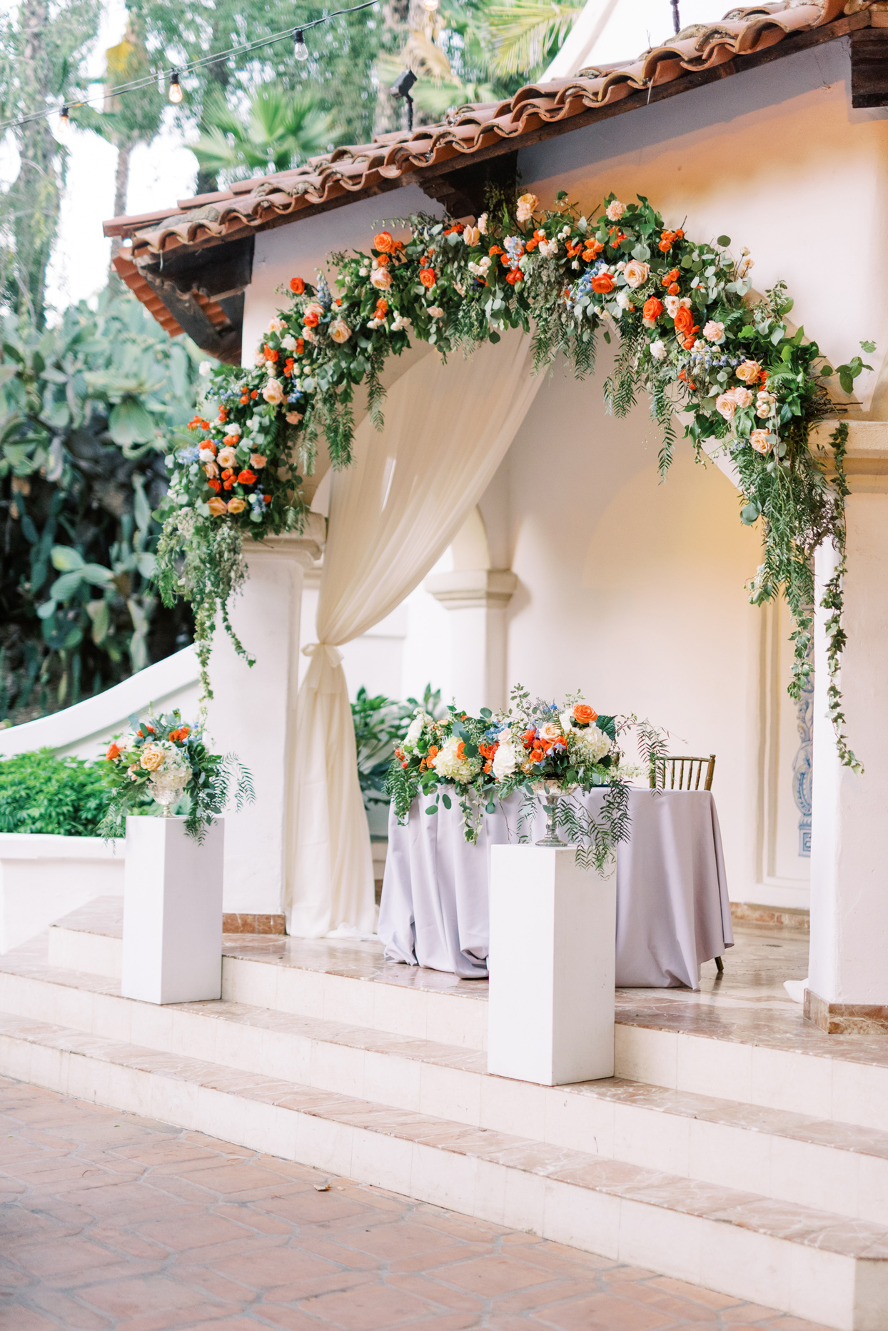 orange floral decor reception sweetheart table