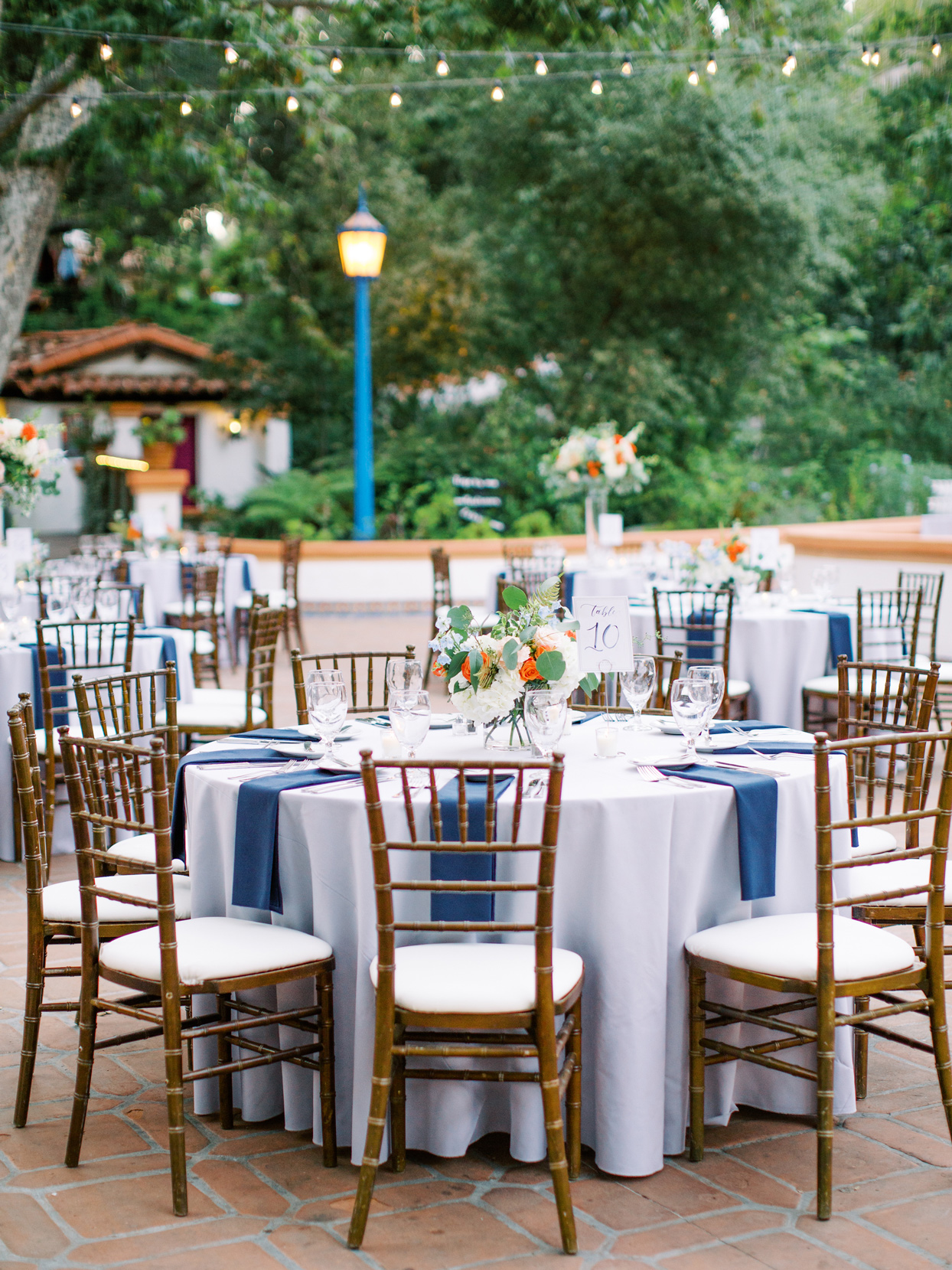 blue linen covered round reception tables outside