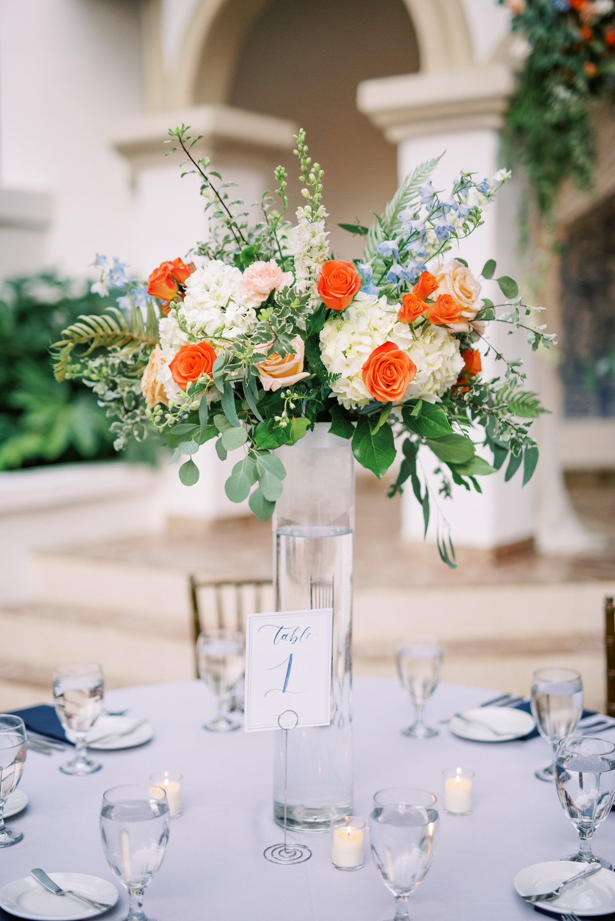 tall orange accented floral centerpieces