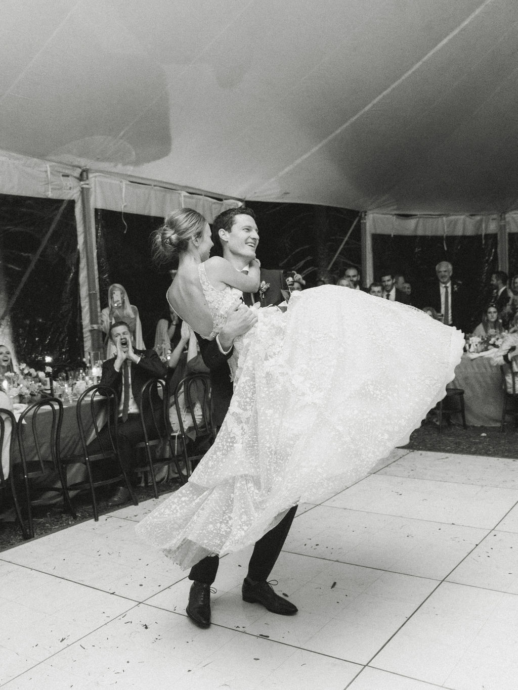 groom lifting bride during first wedding dance