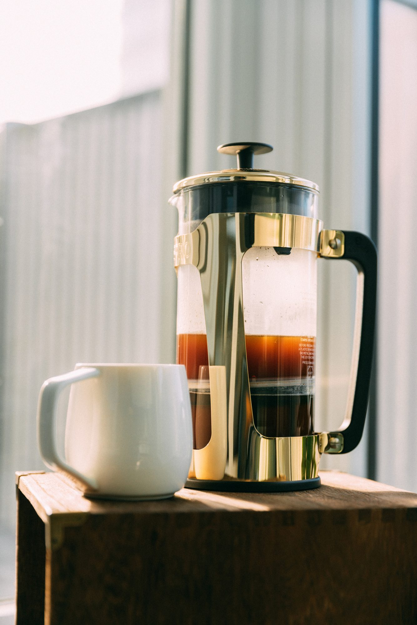 French press coffee maker and mug