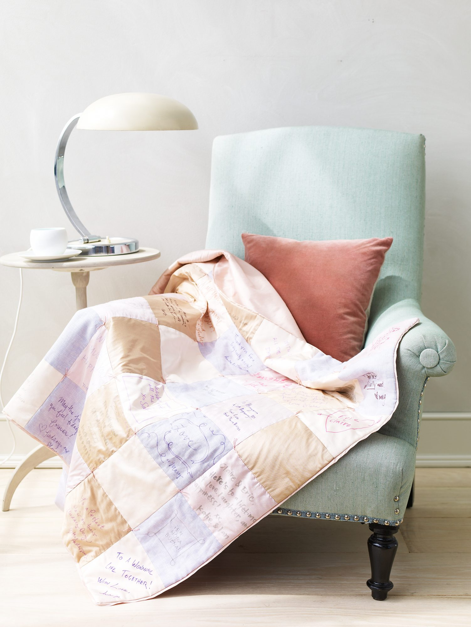 patchwork quilt draped over a chair