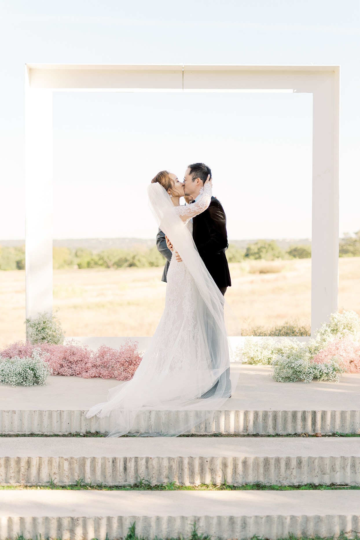 couple kissing during outdoor wedding ceremony
