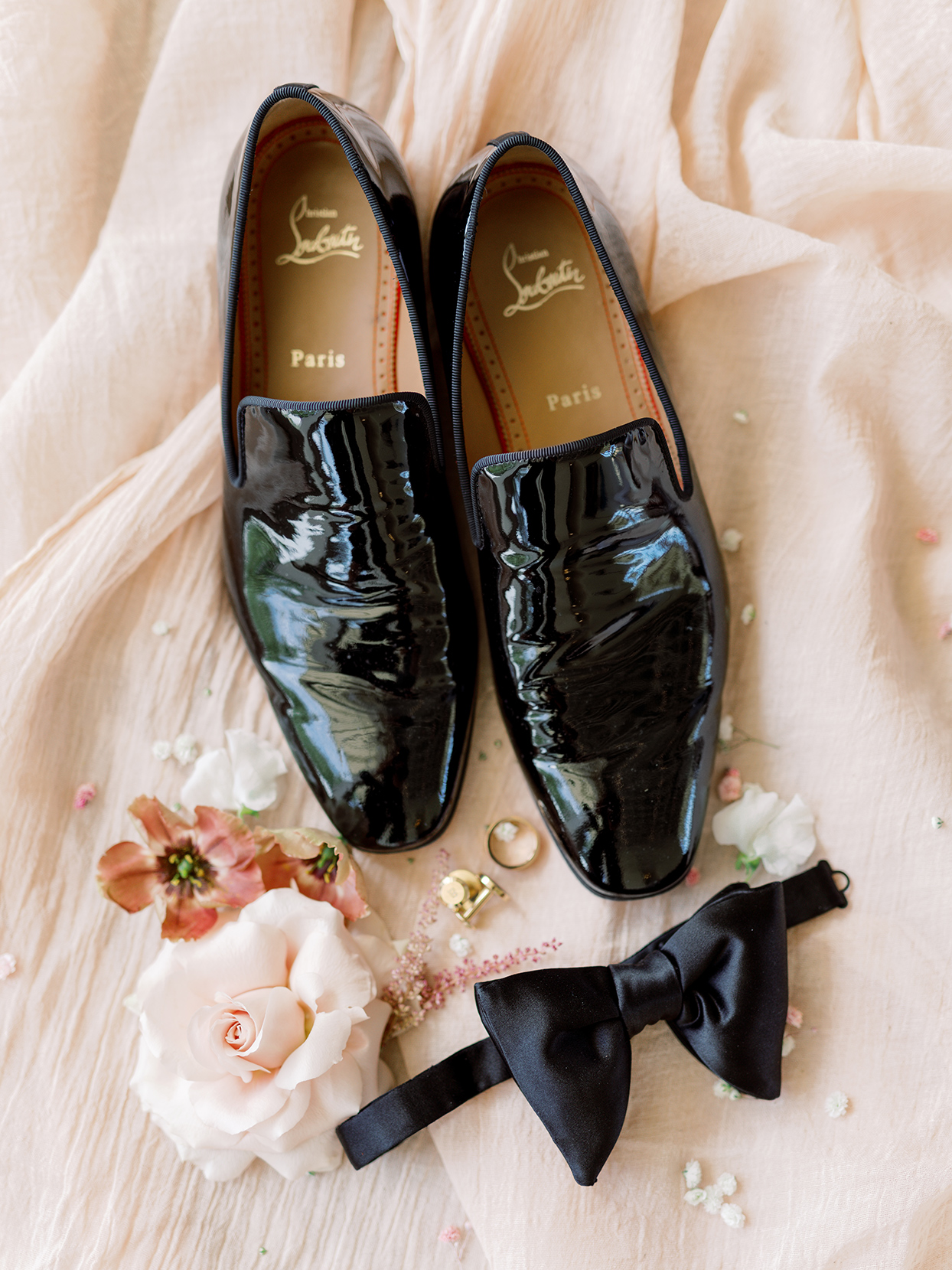 groom's black shoes and bowtie and gold cufflinks wedding accessories