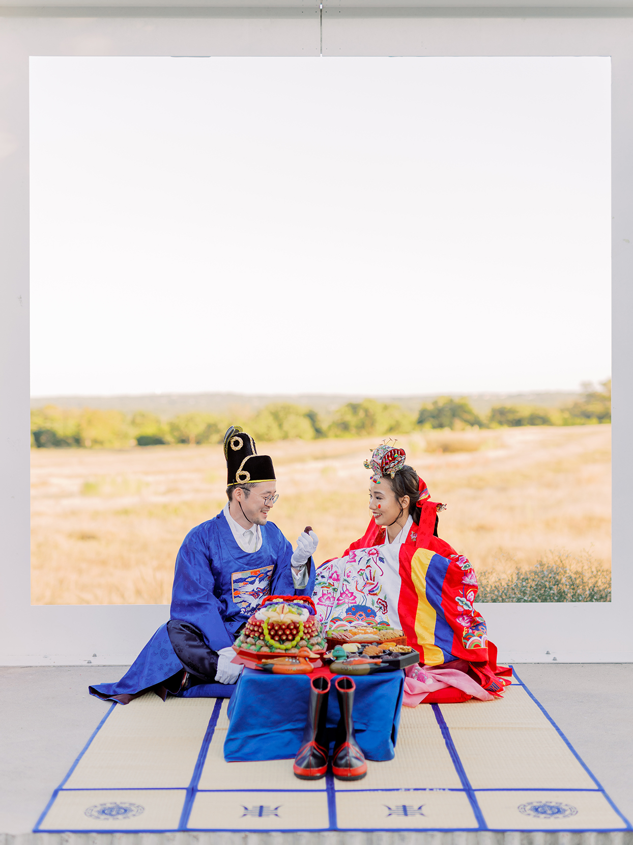 bride and groom wearing traditional korean attire during ceremony