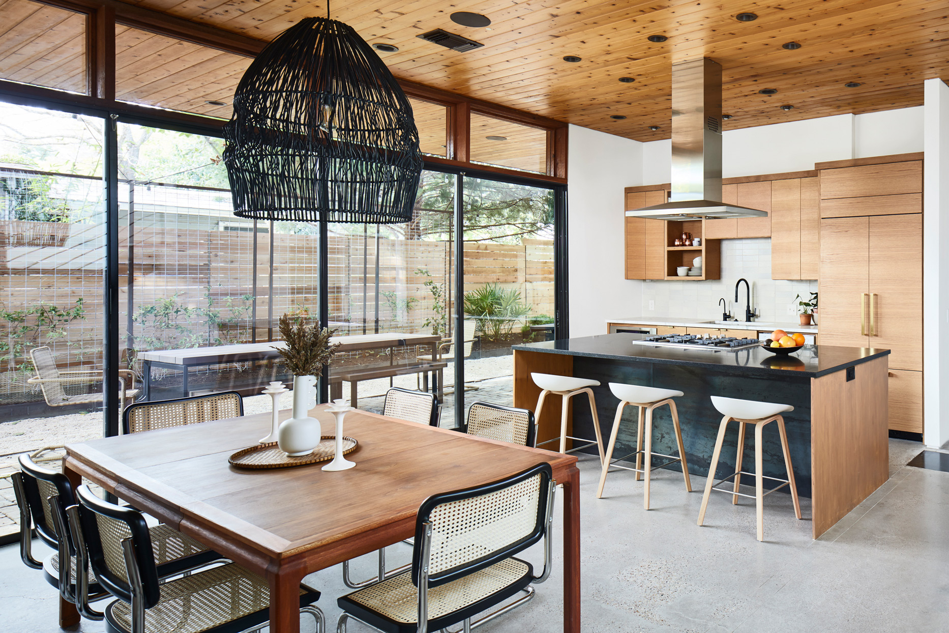 neutral-colored dining room and kitchen with wood accents